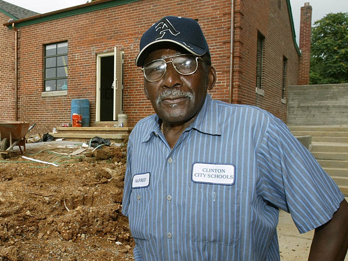 """Alfred Williams, one of 12 black students who integrated Clinton (Tenn.) High School 50 years ago, is shown Monday, Aug. 14, 2006, outside a former schoolhouse in Clinton, Tenn. that will open next week as a museum honoring the """"Clinton 12."""" Clinton High School was the first public high school to desegregate in the Old South."""