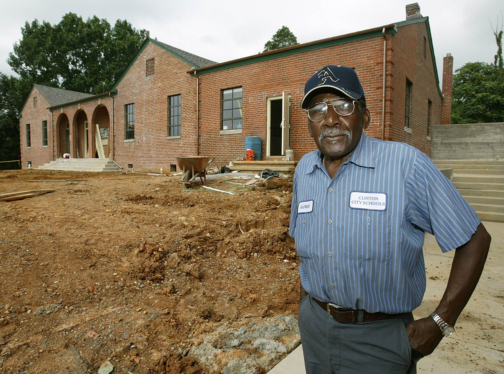 "Alfred Williams, one of 12 black students who integrated Clinton (Tenn.) High School 50 years ago, is shown Monday, Aug. 14, 2006, outside a former schoolhouse in Clinton, Tenn. that will open next week as a museum honoring the ""Clinton 12."" Clinton High School was the first public high school to desegregate in the Old South."