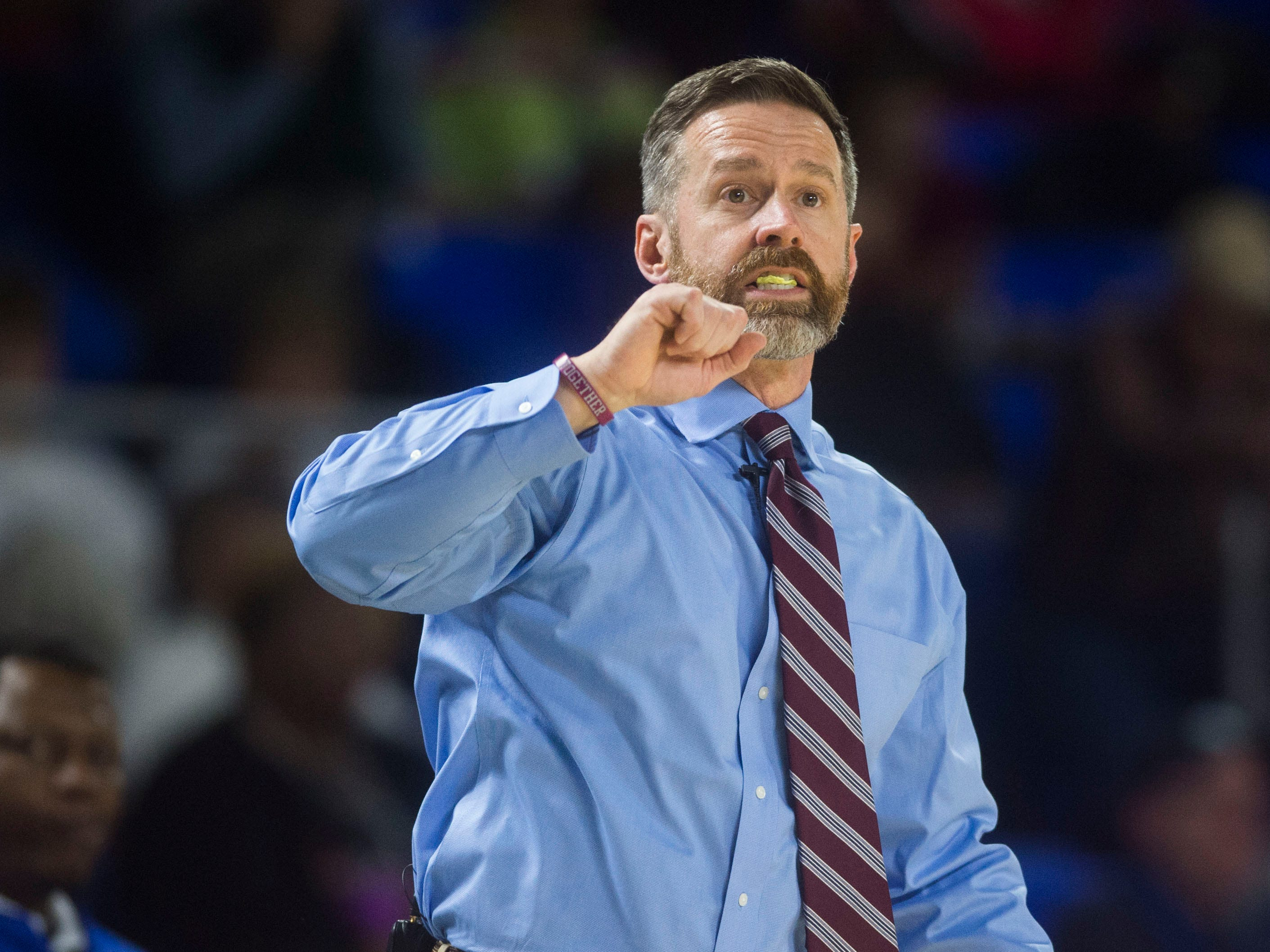 Bearden's head coach Jeremy Parrott yells to the court during a TSSAA AAA state semifinal game between Whitehaven and Bearden at the Murphy Center in Murfreesboro, Friday, March 15, 2019. Bearden defeated Whitehaven 76-60.
