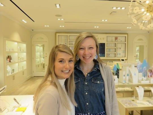 Assistant manager Jami Shell and manager Marissa Campbell stand inside the new Kendra Scott store, which opened in Bearden in January.