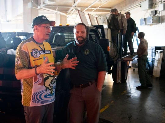 Gene Gilliland, conservation director for B.A.S.S., meets with Jason Henegar, TWRA's assistant chief of fisheries during the first day of the Bassmaster Classic on Friday, March 15, 2019.