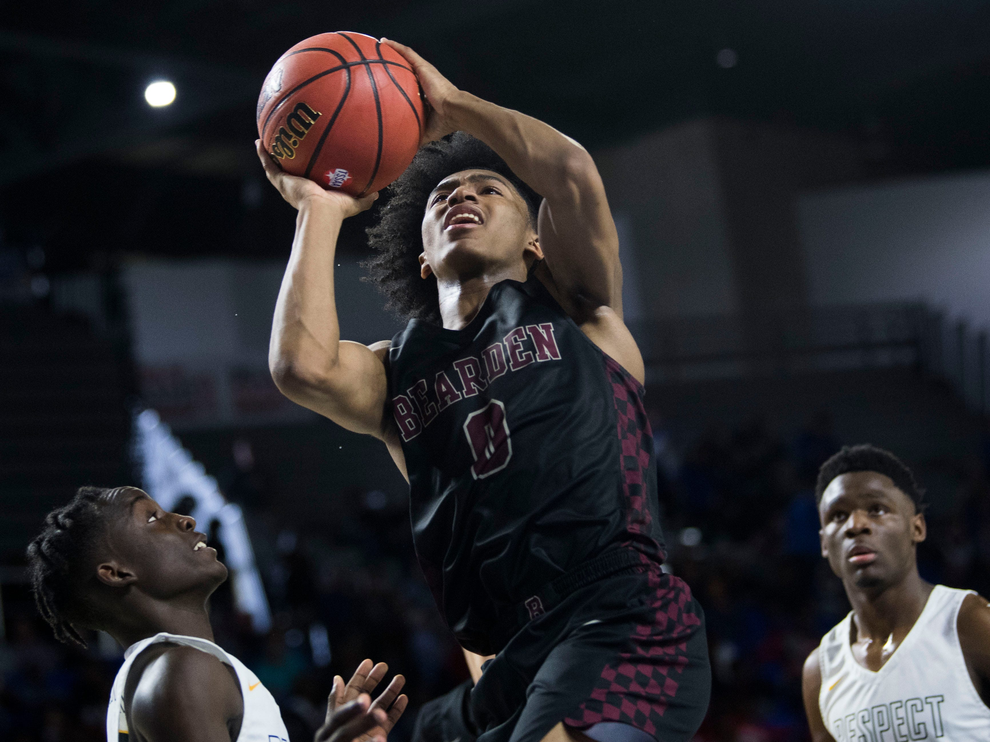 Bearden's Ques Glover (0) takes a shot during a TSSAA AAA state semifinal game between Whitehaven and Bearden at the Murphy Center in Murfreesboro, Friday, March 15, 2019. Bearden defeated Whitehaven 76-60.