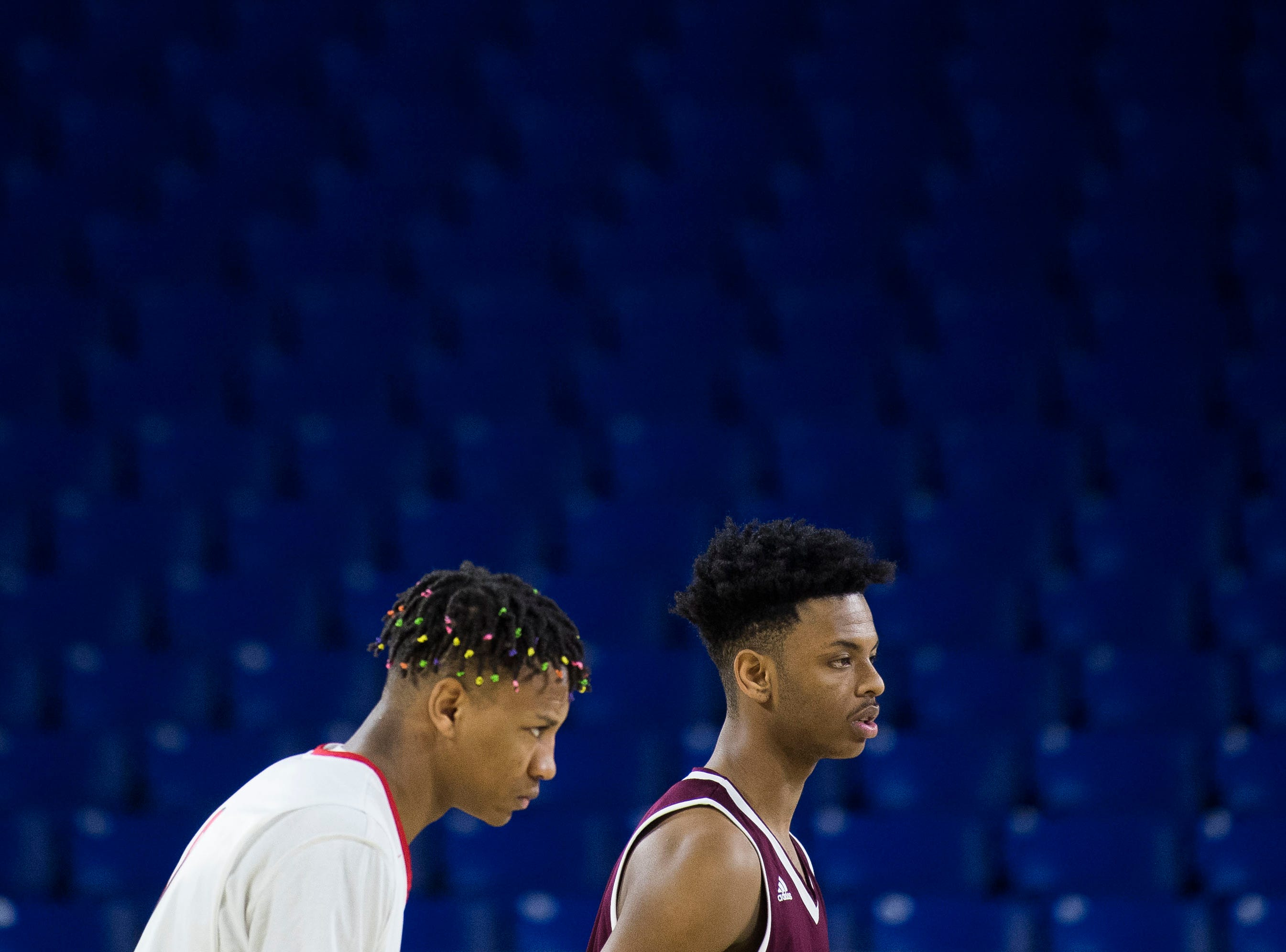 East NashvilleÕs Taras Carter (0) and FultonÕs Trey Davis (2) wait for the game to being before a TSSAA AA state semifinal game between East Nashville and Fulton at the Murphy Center in Murfreesboro, Friday, March 15, 2019.