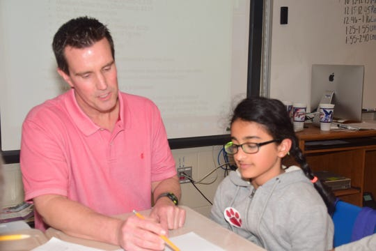Stacy Aycock works on a project with Aditi Gupta, 10, at Ball Camp Elementary School.