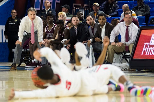FUltons bench watches on during a TSSAA AA state semifinal game between East Nashville and Fulton at the Murphy Center in Murfreesboro, Friday, March 15, 2019.