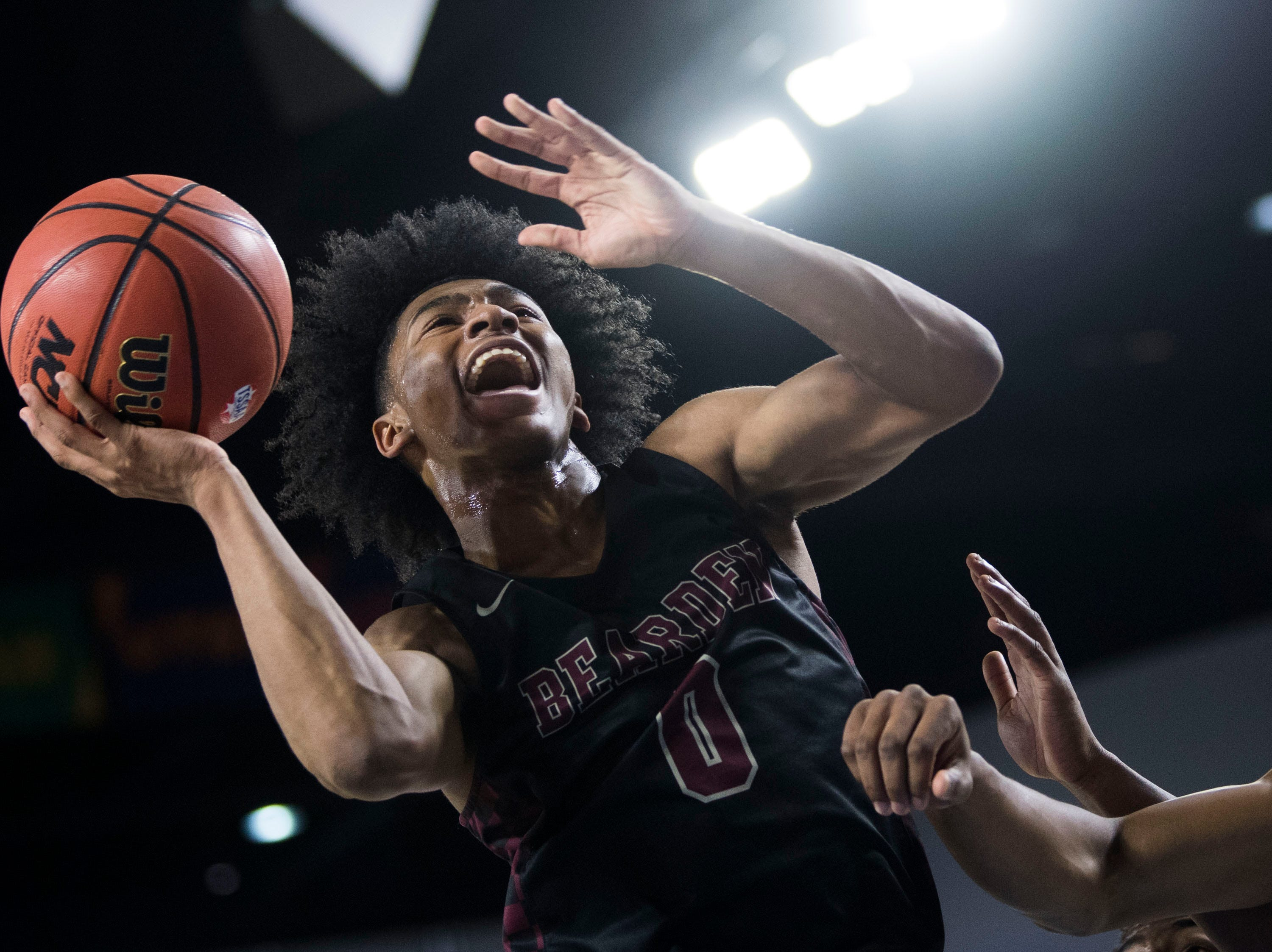 Bearden's Ques Glover (0) takes a shot during a TSSAA AAA state semifinal game between Whitehaven and Bearden at the Murphy Center in Murfreesboro, Friday, March 15, 2019.
