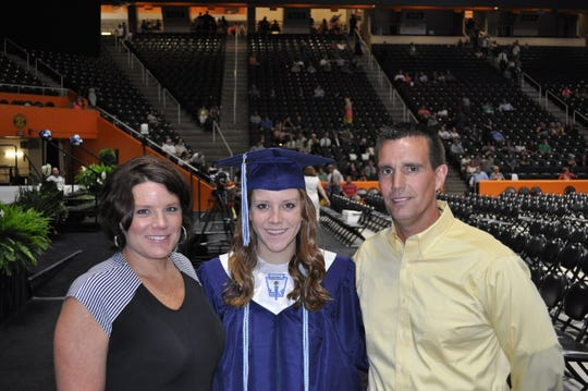 Stacy Aycock with wife Kristen Aycock (left) and daughter Courtney Aycock at her graduation from high school May 2014.