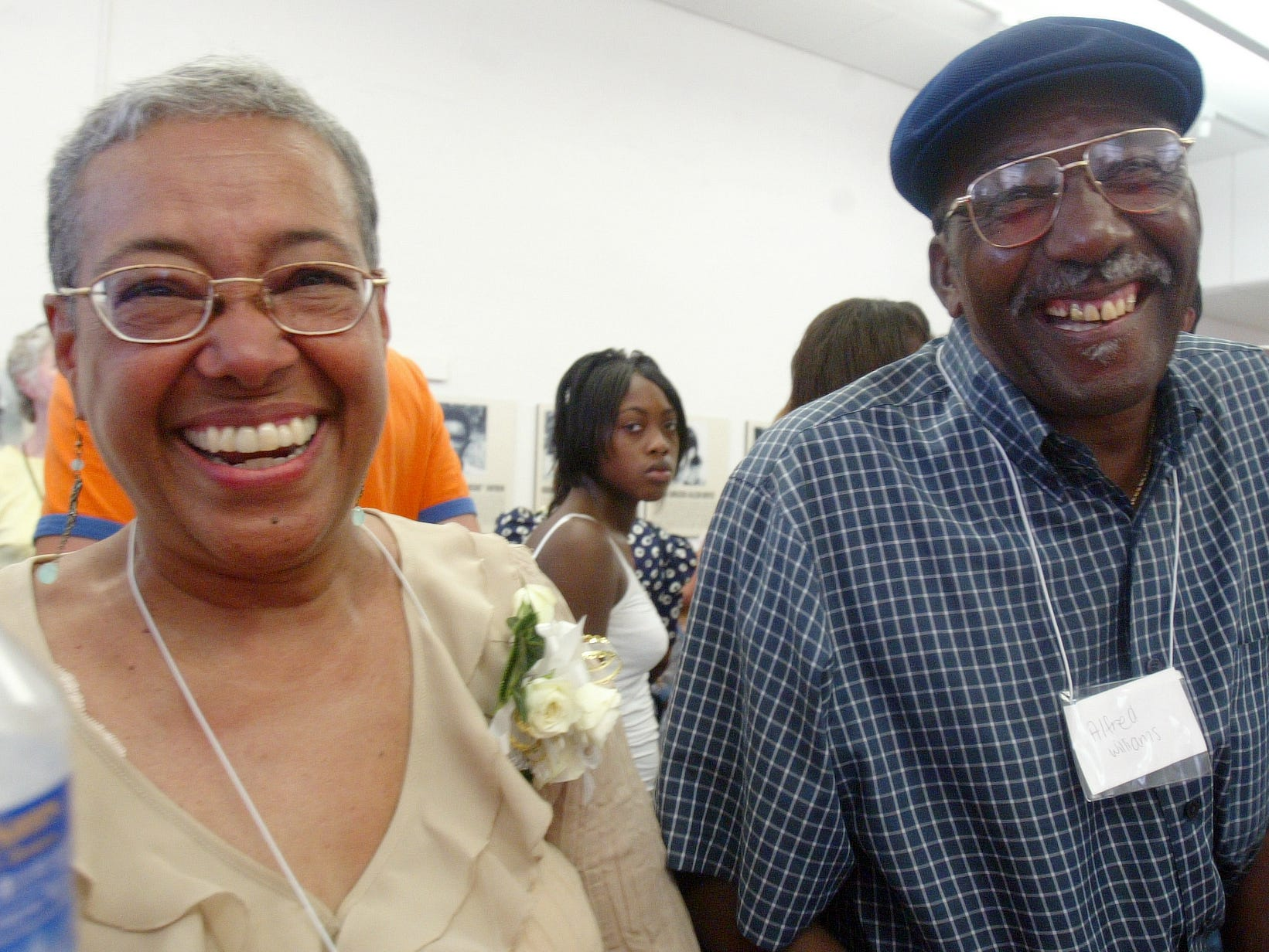 Jo Ann Allen Boyce, left, and Alfred Williams, both members of the Clinton 12,  a name given to the first black students to integrate Clinton High School in 1956, share a laugh after a ceremony held in their honor on Saturday in Clinton. Ten of the twelve members attended the weekend festivities. 08/26/06