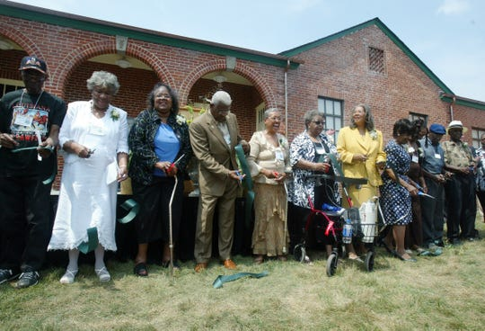 Members of the famous Clinton 12 who were the first to desegregate a public school, cut a ribbon opening the Green McAdoo Cultural Center and Museum on Saturday in Clinton. Ten of the twelve returned for the weekend festivities celebrating the historic  event. The Clinton 12 include William Latham, left Minnie Ann Dickey Jones, Theresser Caswell, Bobby Cain, JoAnn Allen Boyce, Alvah McSwain Lambert, Gail Ann Epps Upton, Regina Turner Smith, Valerie Weaver the daughter of Robert Thacker, Alfred Williams and Maurice Soles. In 1956 these students walked from Green McAdoo School to start integration at the all-white Clinton High School. 08/26/06