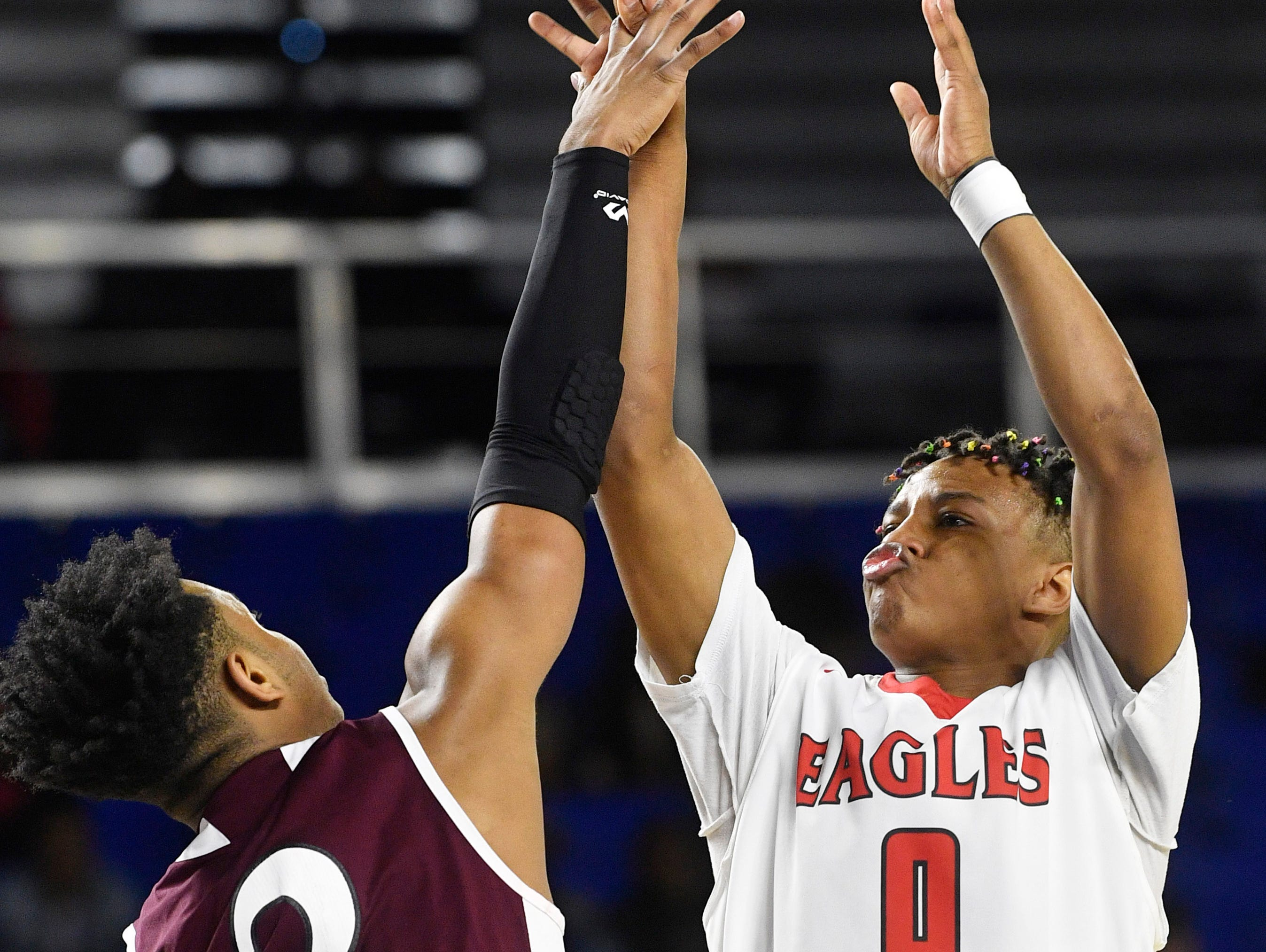 East Nashville Taras Carter (0) takes a shot as East Nashville plays Fulton in the TSSAA Class AA semifinal  Friday, March 15, 2019, in Murfreesboro, Tenn.