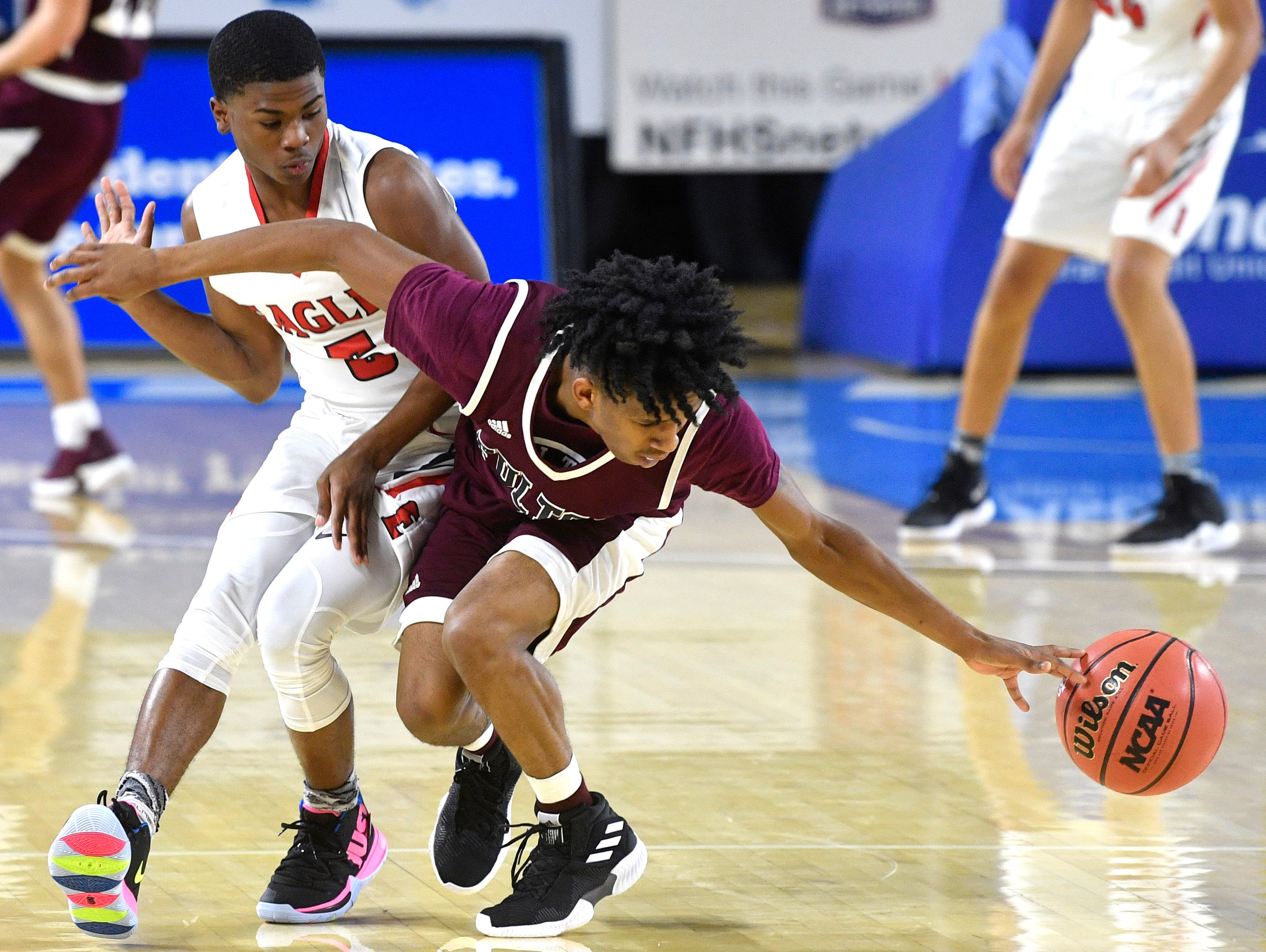 East Nashville Joshua Cole (2) knock the ball loose from Fulton's Edward Lacy (4) as East Nashville plays Fulton in the TSSAA Class AA semifinal  Friday, March 15, 2019, in Murfreesboro, Tenn.