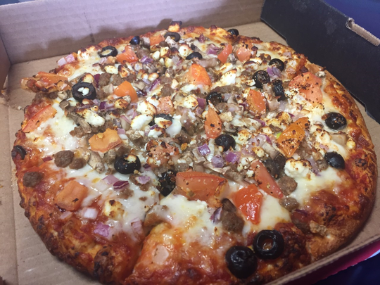 One option at Smokeys Pizza is the Mediterranean, made with beef, onion, tomato, mushroom, black olives and feta cheese.
