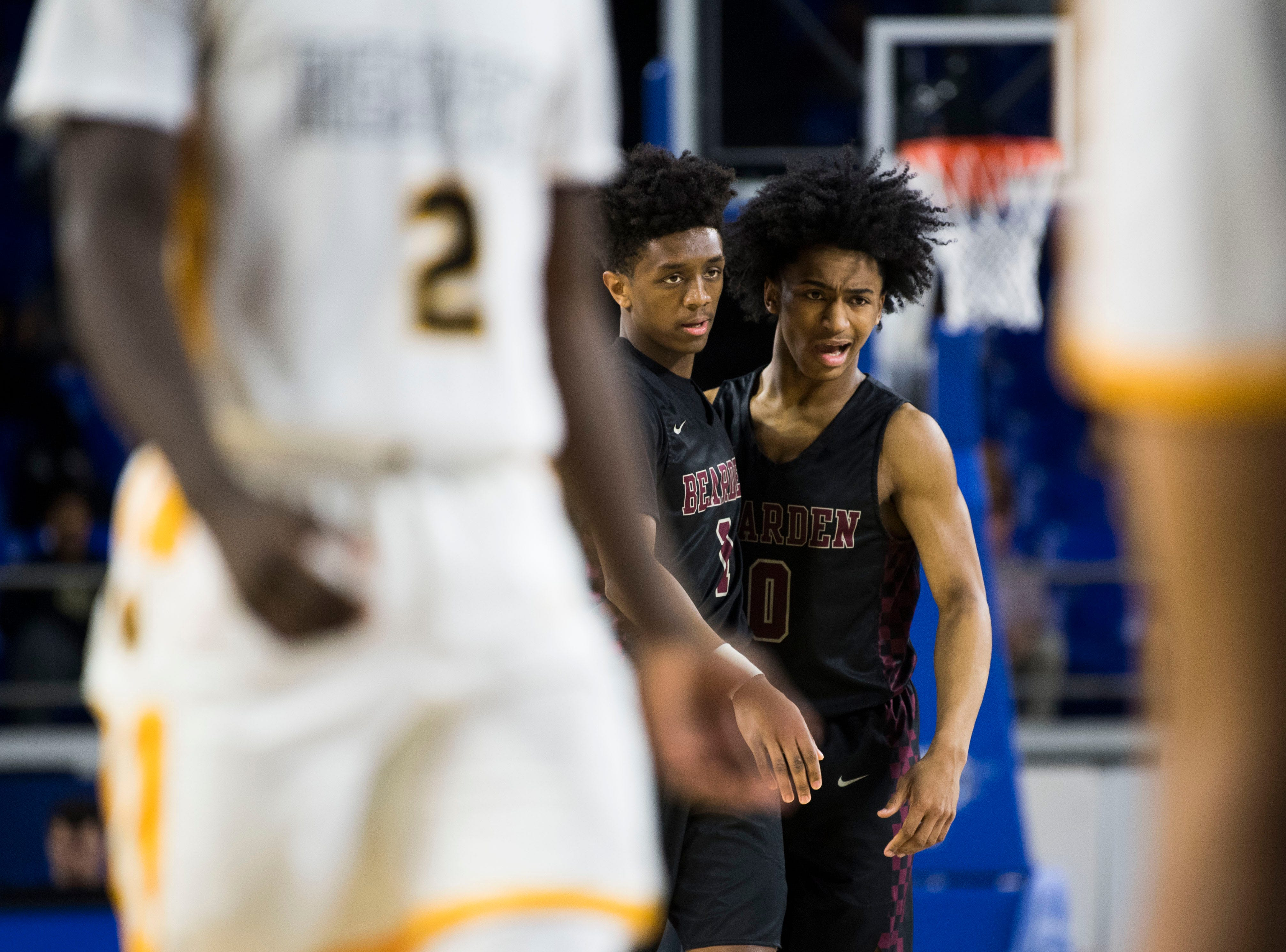 Bearden's Ques Glover (0) and Bearden's Trent Stephney (1) talk on the court during a TSSAA AAA state semifinal game between Whitehaven and Bearden at the Murphy Center in Murfreesboro, Friday, March 15, 2019.