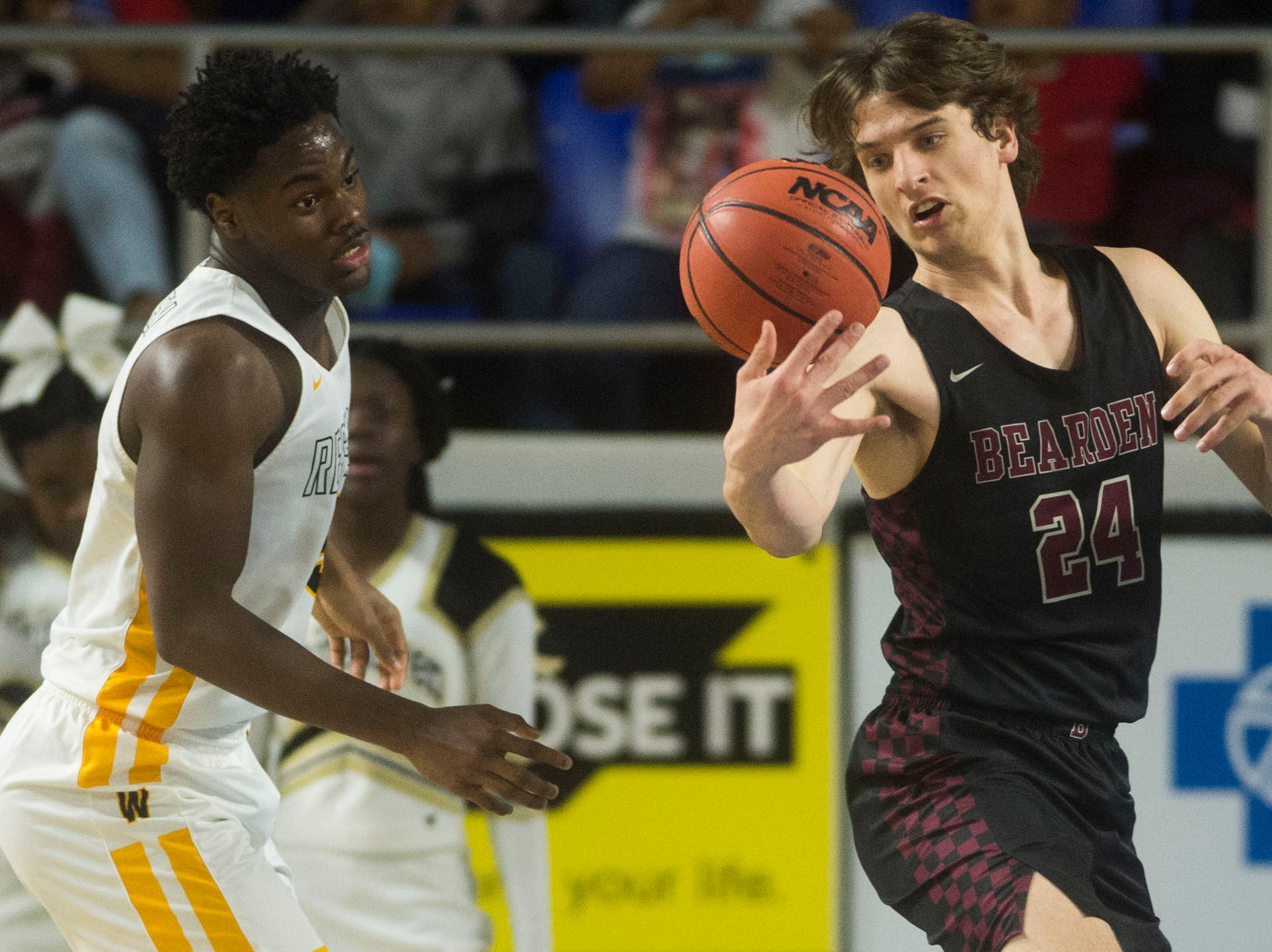Bearden's Kordell Kah (24) attempts to maintain possession of the ball during a TSSAA AAA state semifinal game between Whitehaven and Bearden at the Murphy Center in Murfreesboro, Friday, March 15, 2019. Bearden defeated Whitehaven 76-60.