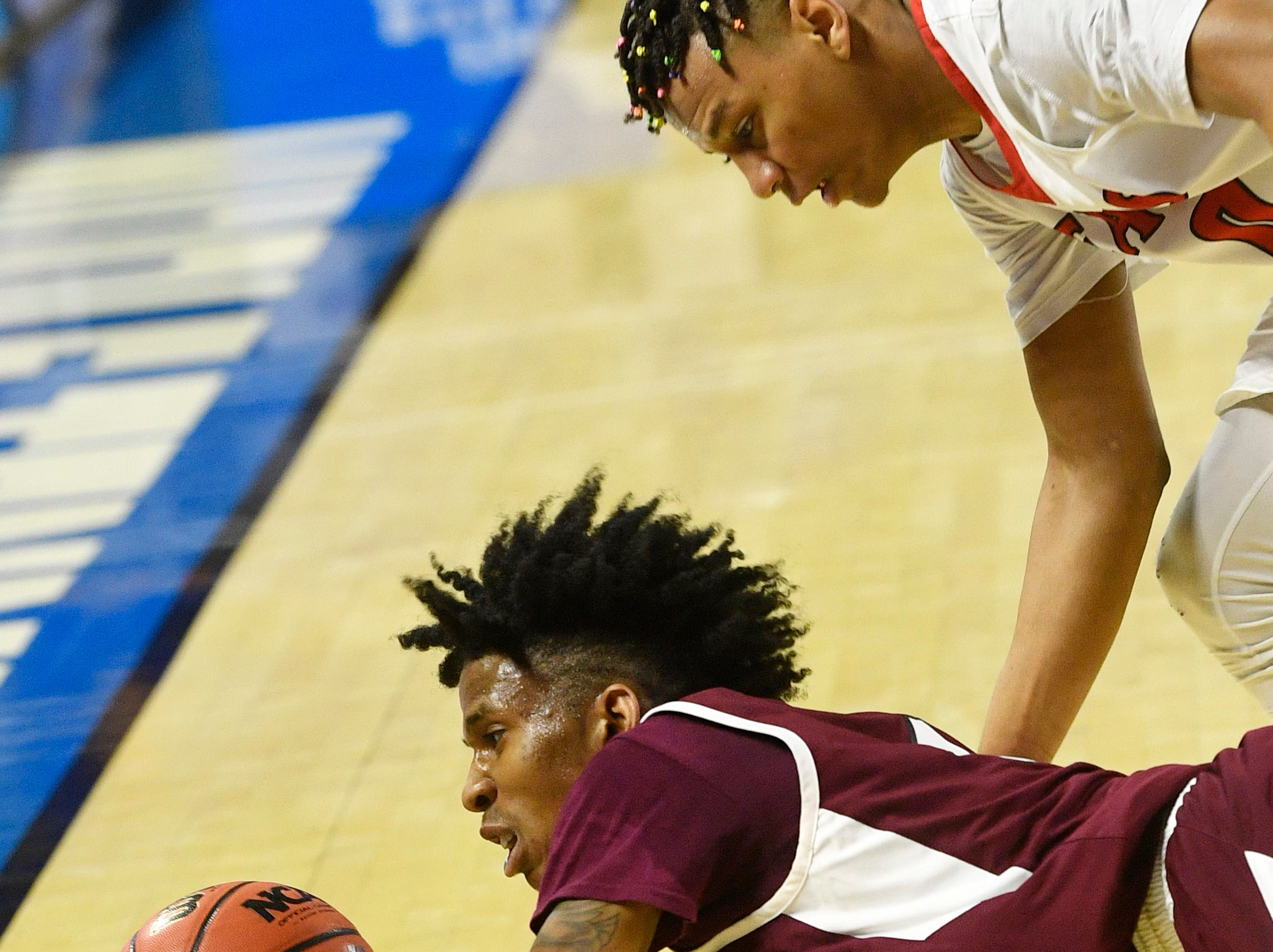 Fulton Edward Lacy (4) tries to save a ball going out of bounds as East Nashville plays Fulton in the TSSAA Class AA semifinal  Friday, March 15, 2019, in Murfreesboro, Tenn.