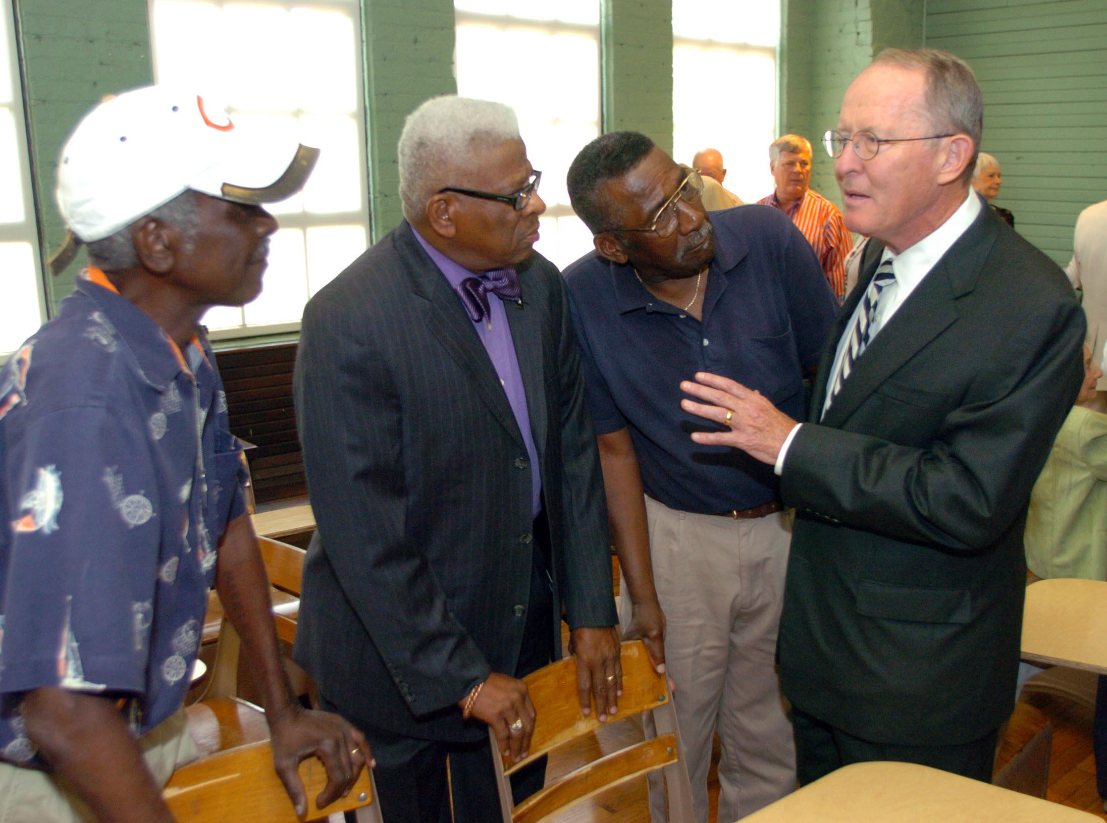 U.S. Senator Lamar Alexander talks with three of the Clinton Twelve before a ceremony honoring former Governor Frank G. Clement's role in desegregation of Clinton High School on Wednesday at the Green McAdoo Cultural Center and Museum. From left, are Maurice Soles, Bobby Cain, Alfred Williams and Alexander.