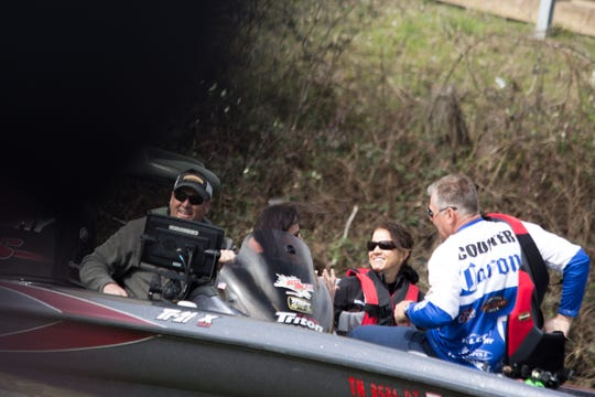 Tennessee first lady Maria Lee, center,  rides in a boat with professional angler Brandon Coulter, right, Knoxville firefighter Mike Miles, left, and TWRA Commissioner Angie Box during a fishing trip to support the Bassmaster Classic in Knoxville on Friday, March 15, 2019.