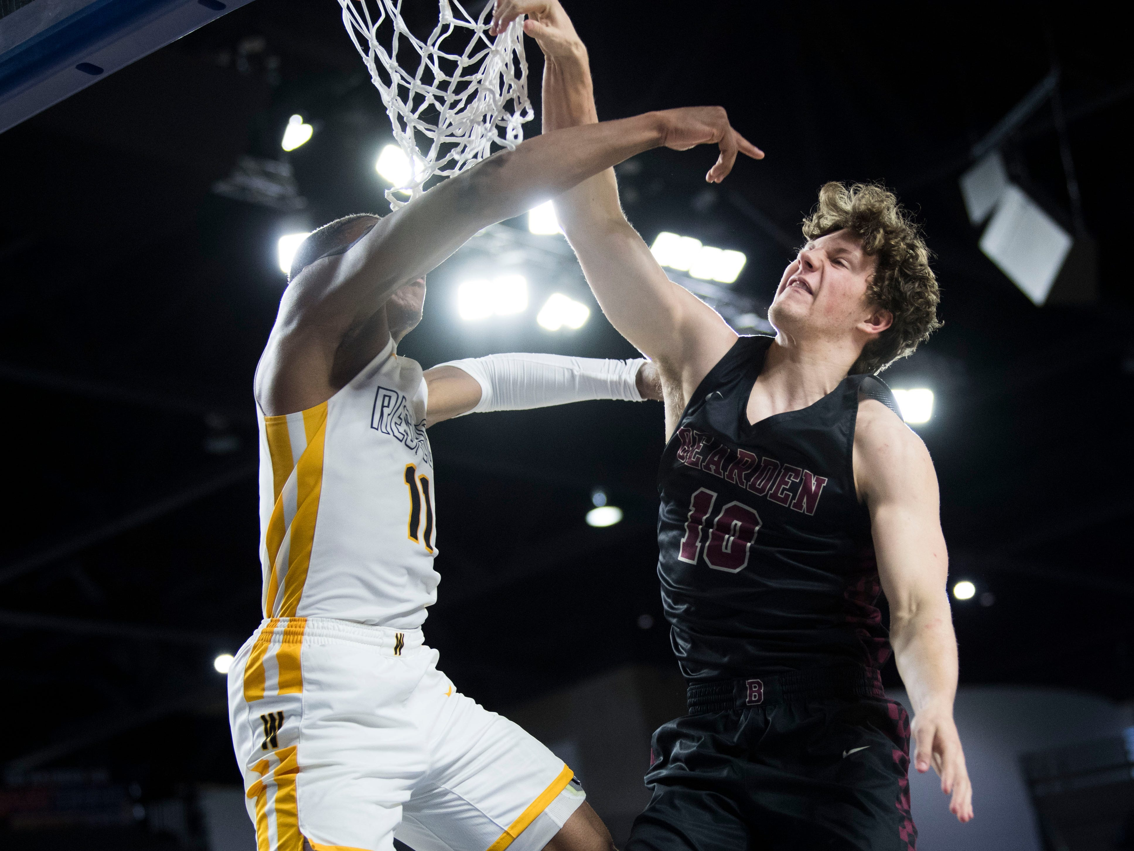 Bearden's Tyler Nordin (10) takes a shot while fouled by Whitehaven's Matthew Murrell (11)during a TSSAA AAA state semifinal game between Whitehaven and Bearden at the Murphy Center in Murfreesboro, Friday, March 15, 2019. Bearden defeated Whitehaven 76-60.