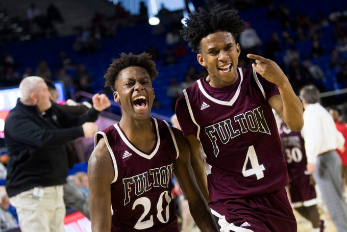 Fulton's Domenic Holland (20) and Fulton's Edward Lacy (4) celebrate a win after a TSSAA AA state semifinal game between East Nashville and Fulton at the Murphy Center in Murfreesboro, Friday, March 15, 2019. Fulton defeated East Nashville 66-55.