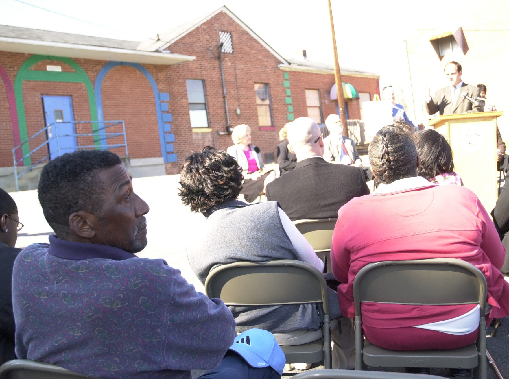 "Alfred Williams, left, one of the ""Clinton 12"" who integrated Clinton High School 50 years ago, listens as U.S. Rep. Zach Wamp, in background, talks during groundbreaking for a new civil-rights museum that will be located in the Green McAdoo School building, behind Wamp. Before integration, black students throughout the area attended elementary school in the building, formerly known as the Clinton Colored School. Feb. 23, 2006"
