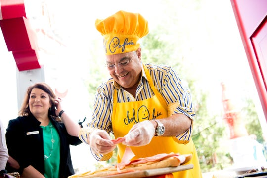 Cuban celebrity chef Chef Pepin prepares his Cuban sandwiches at Dollywood in Pigeon Forge, Tennessee on Friday, March 15, 2019. Dolly Parton was visiting the park to kick off the 2019 season and give updates on the Wildwood Grove expansion.