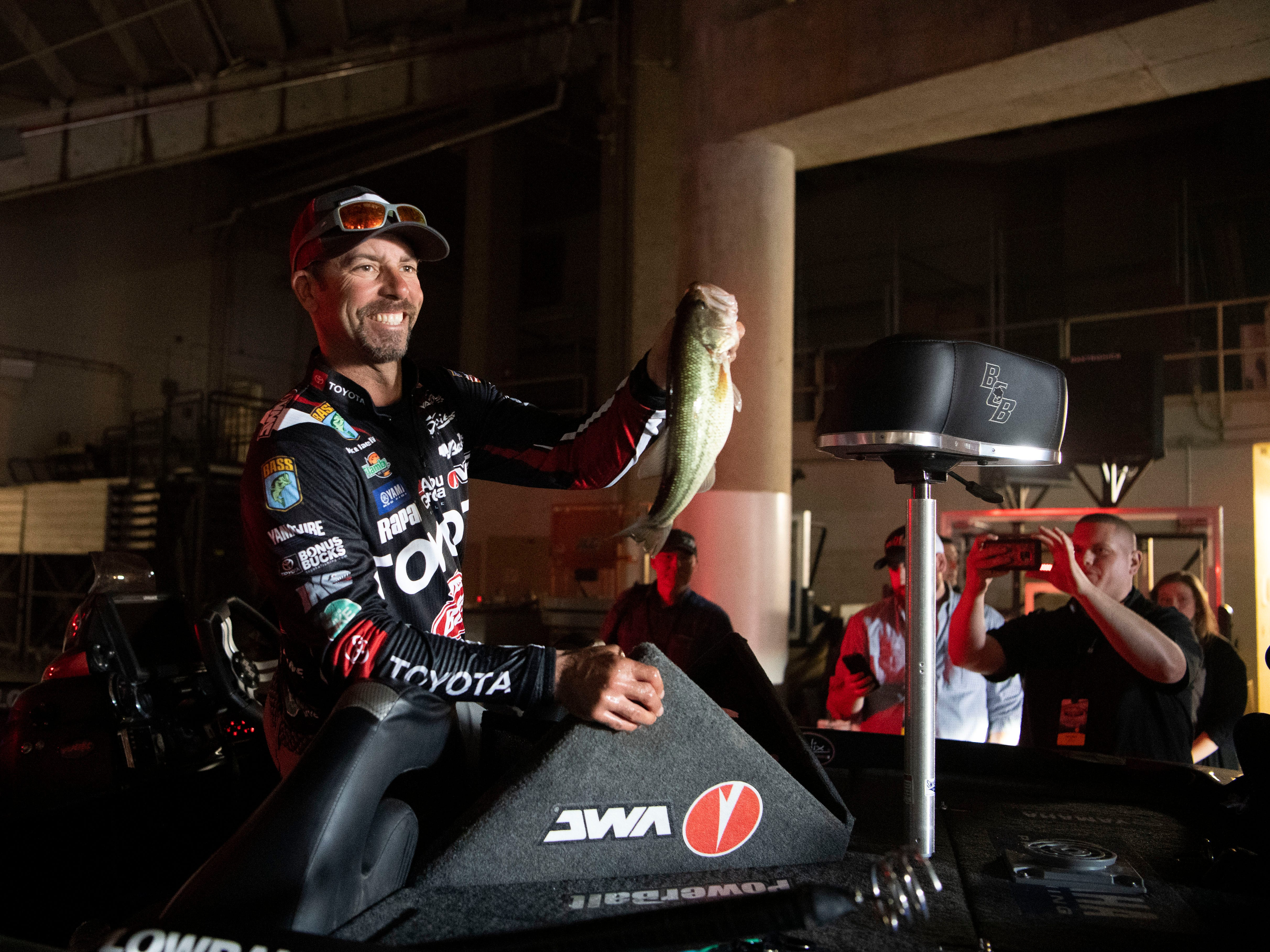 Professional bass fisherman Mike Iaconelli shows one of his catches, a largemouth bass, before weigh-in on the first day of the GEICO Bassmaster Classic presented by DICKÕS Sporting Goods at Thompson-Boling Arena on Friday, March 15, 2019.