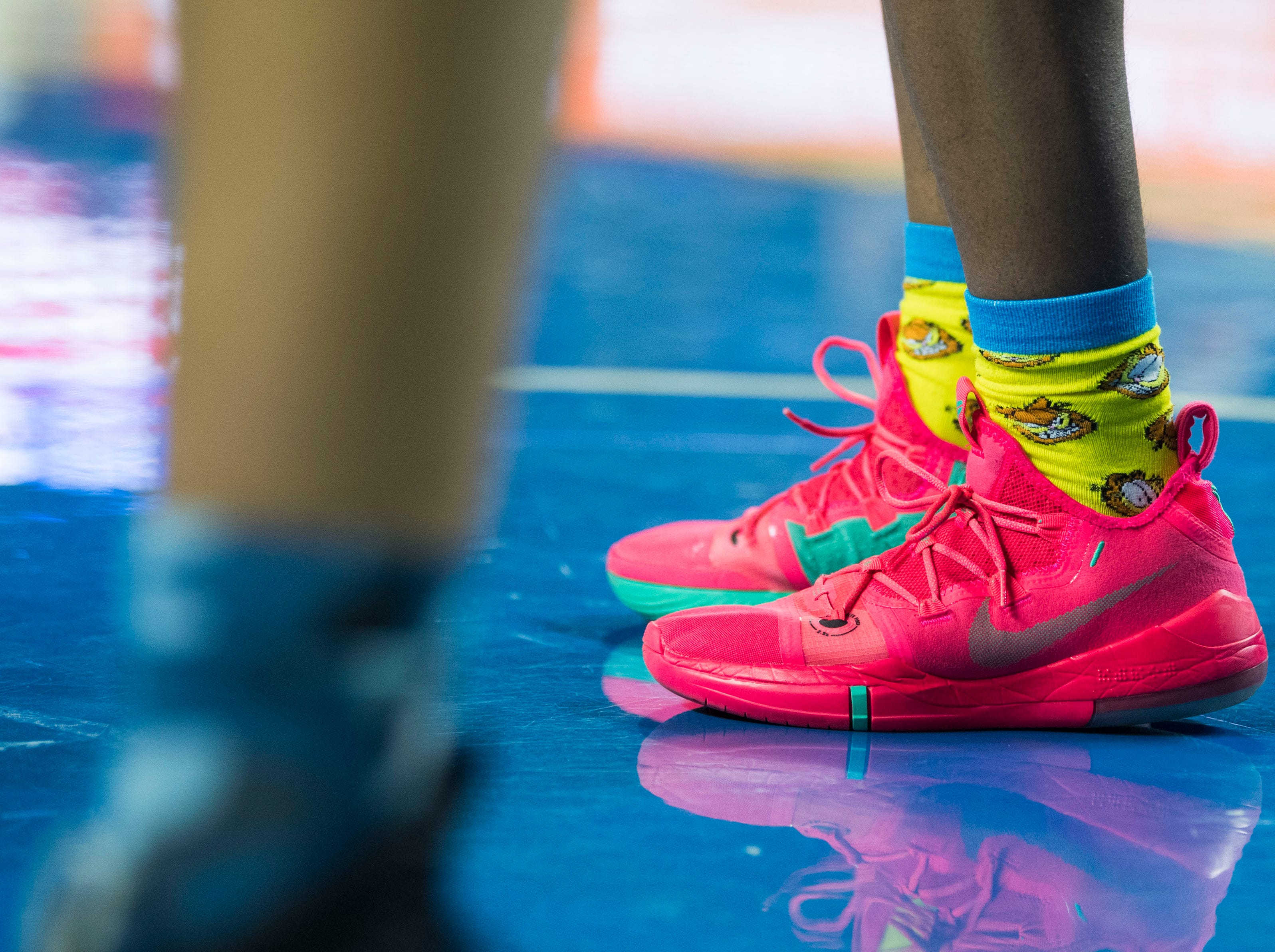 An East Nashville player wears colorful shoes during a TSSAA AA state semifinal game between East Nashville and Fulton at the Murphy Center in Murfreesboro, Friday, March 15, 2019. Fulton defeated East Nashville 66-55.