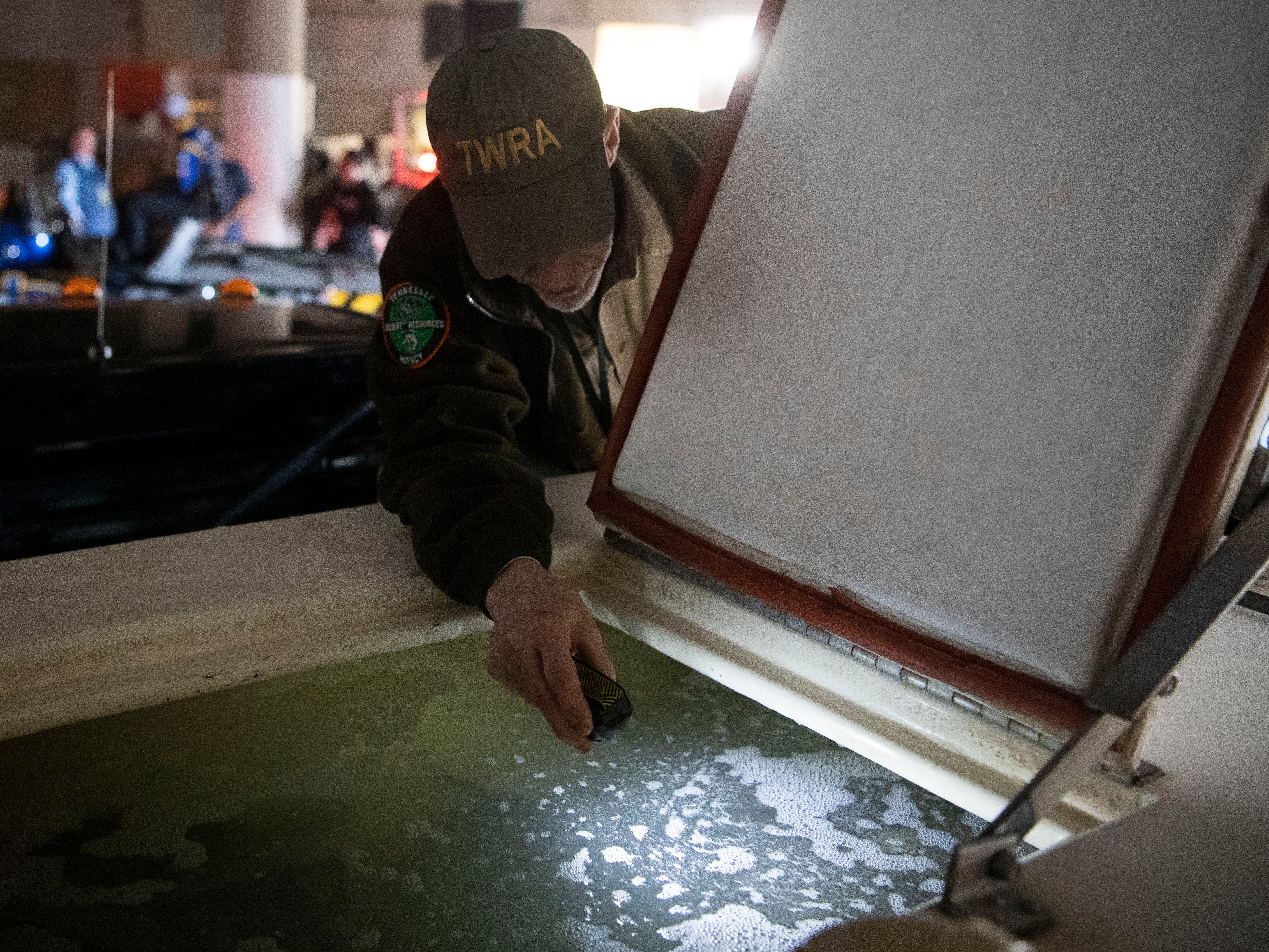 A Tennessee Wildlife Resources Agency technician monitors the water quality where the bass are held after they are weighed in at the Bassmaster Classic on Friday, March 15, 2019. The bass are released back into Fort Loudon Lake at locations TWRA will not reveal.