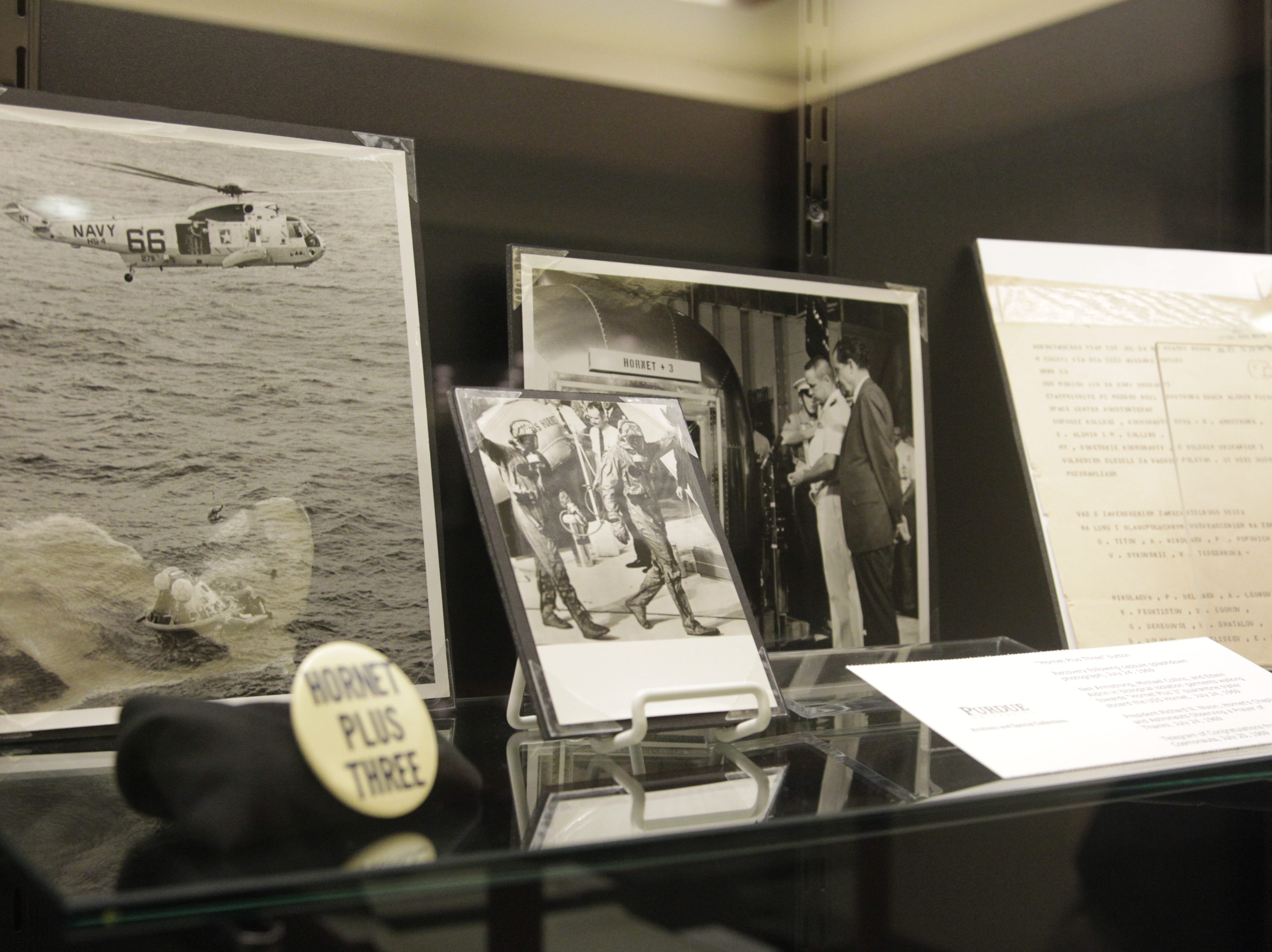 Photos of Neil Armstrong, Buzz Aldrin and Mike Collins in quarantine after Apollo 11 are on display.