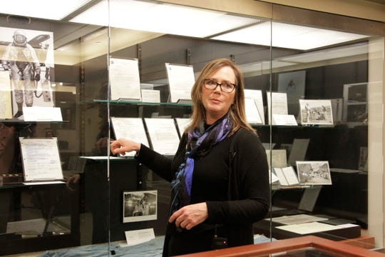 """Archivist Tracy Grimm sorted through 450 boxes of donated personal items from Neil Armstrong and curated """"Apollo in the Archives: Selections from the Neil A. Armstrong Papers."""""""
