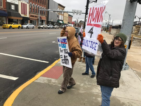Charlotte New, right, and Donna Howard-Leak join about a dozen people protesting Friday, March 15, in downtown Crawfordsville, in the name of Glenn Rightsell, a Linden man killed by an Indiana State Police trooper as he worked on his daughter's SUV along U.S. 231 on Dec. 28. On March 6, the Montgomery County prosecutor decided there wasn't sufficient evidence to charge Trooper Daniel Organ in the fatal shooting.