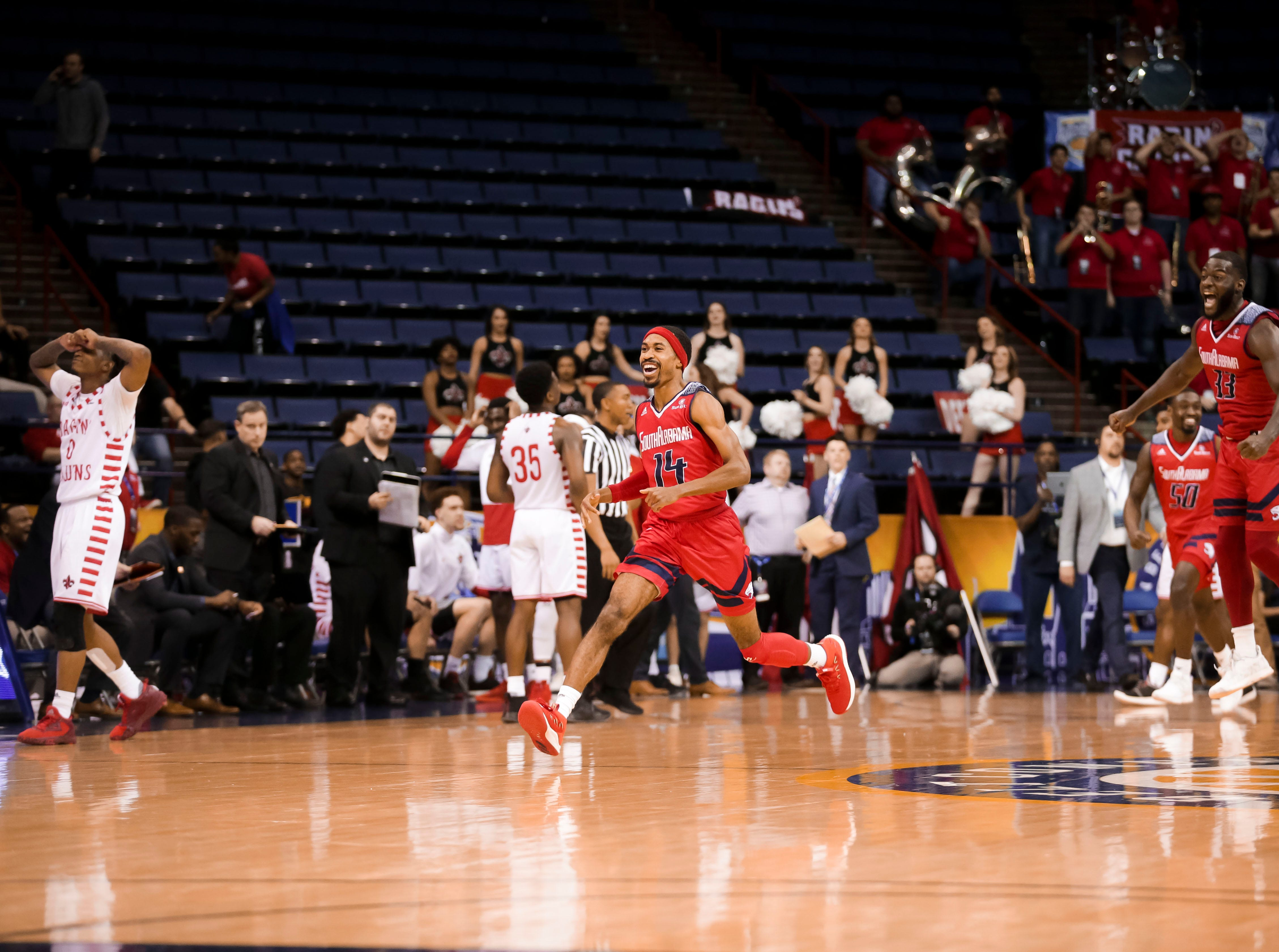 UL and South Alabama players react as the Ragin' Cajuns fell to South Alabama, 70-69, on Thursday at the Sun Belt Men's Basketball Championship in New Orleans.