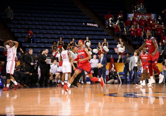 UL and South Alabama players react after the Ragin' Cajuns' last-second loss in last season's Sun Belt Conference Tournament at largely empty Lakefront Arena in New Orleans. The tourney no longer is being held at Lakefront.