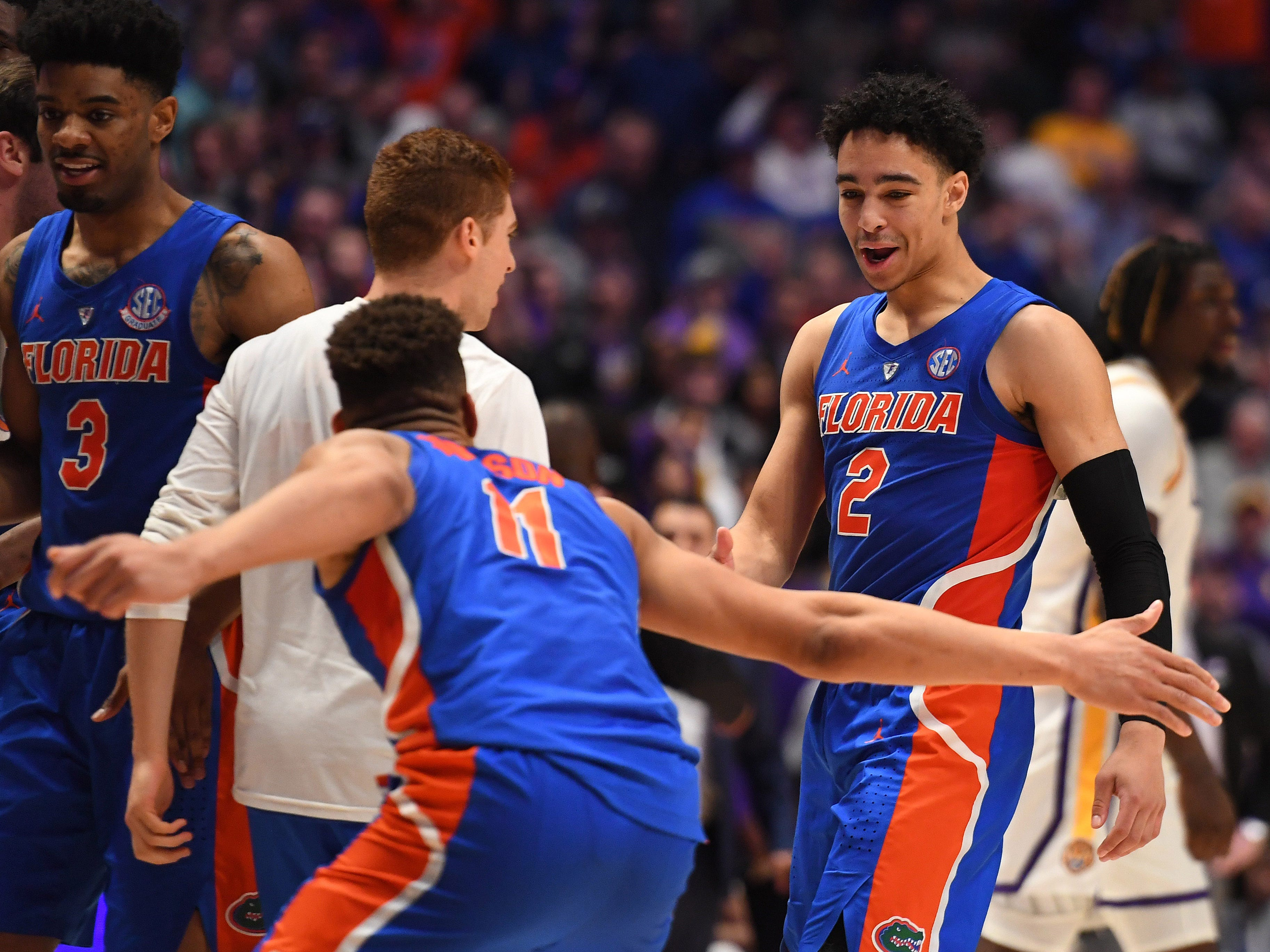 Mar 15, 2019; Nashville, TN, USA; Florida Gators guard Andrew Nembhard (2) celebrates with Gators forward Keyontae Johnson (11) after scoring the game-winning shot against the LSU Tigers during the second half of the SEC conference tournament at Bridgestone Arena. Mandatory Credit: Christopher Hanewinckel-USA TODAY Sports