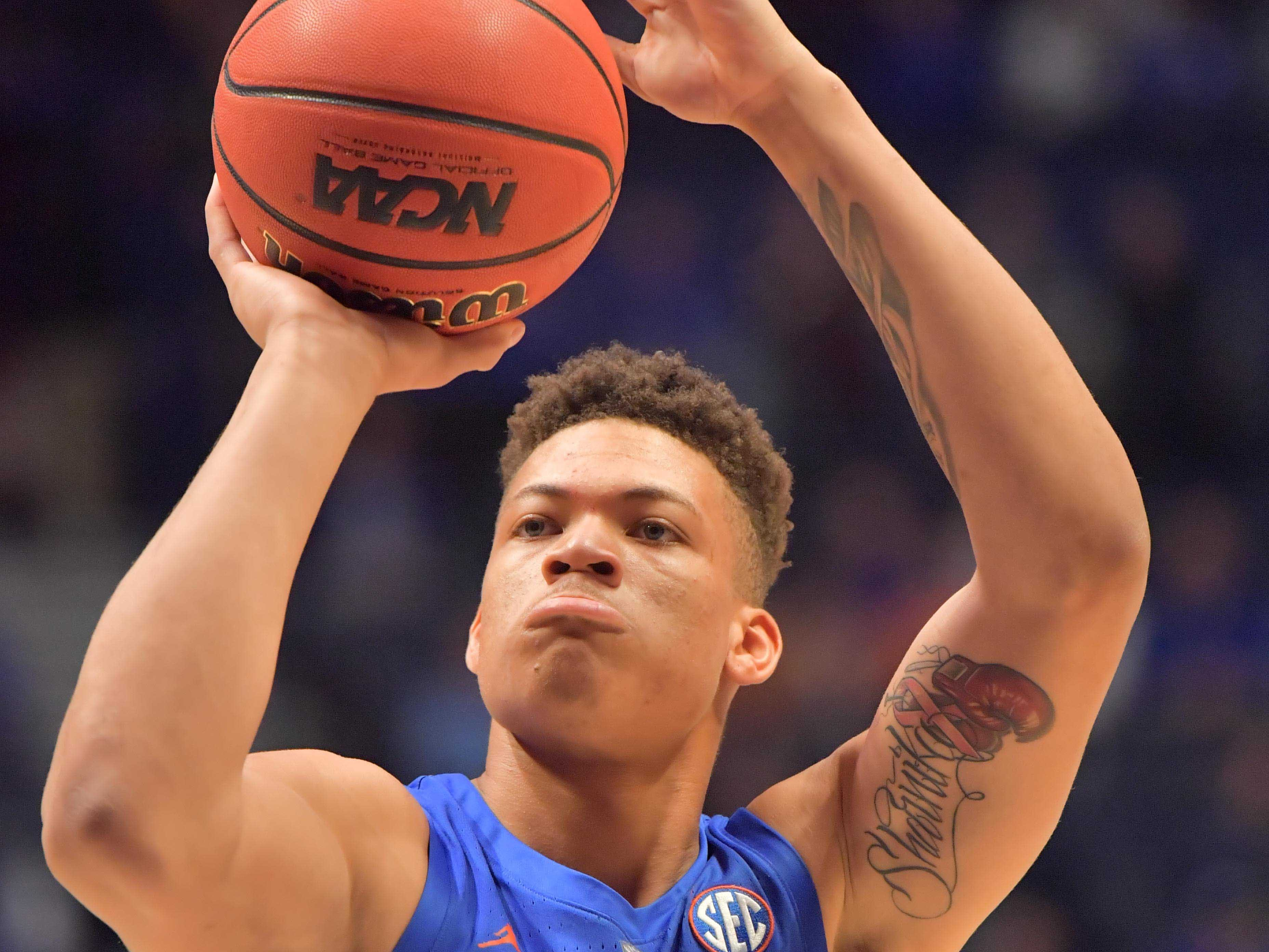 Mar 15, 2019; Nashville, TN, USA; Florida Gators forward Keyontae Johnson (11) shoots a free throw against the LSU Tigers during the first half of game seven in the SEC conference tournament at Bridgestone Arena. Mandatory Credit: Jim Brown-USA TODAY Sports
