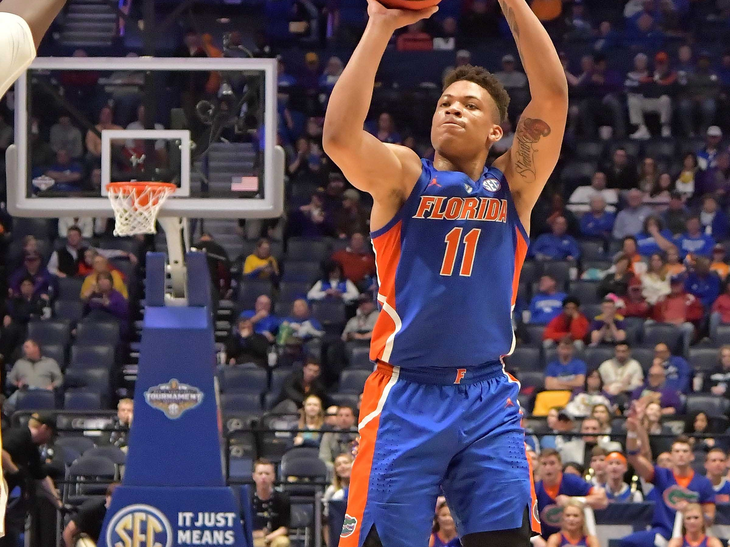 Mar 15, 2019; Nashville, TN, USA; Florida Gators forward Keyontae Johnson (11) shoots against the LSU Tigers during the first half of game seven in the SEC conference tournament at Bridgestone Arena. Mandatory Credit: Jim Brown-USA TODAY Sports