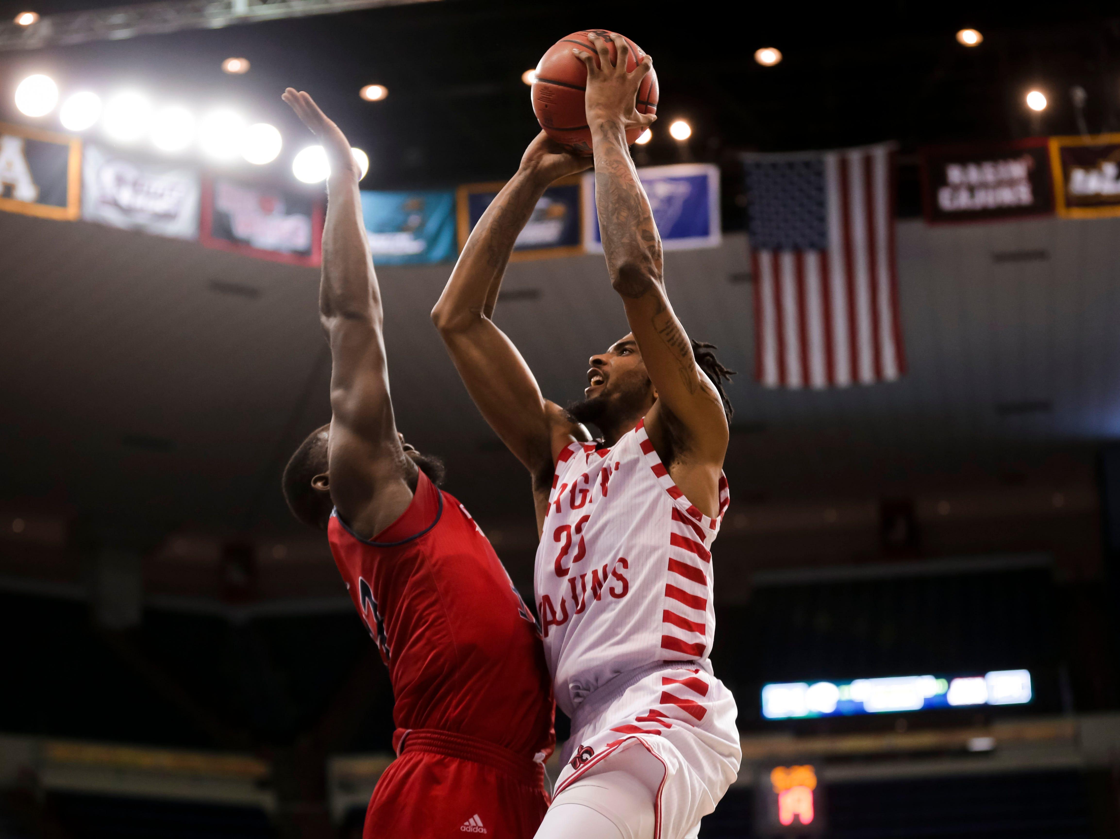 Jakeenan Gant goes up for a basket against South Alabama on Thursday at the Sun Belt Men's Basketball Championship in New Orleans.
