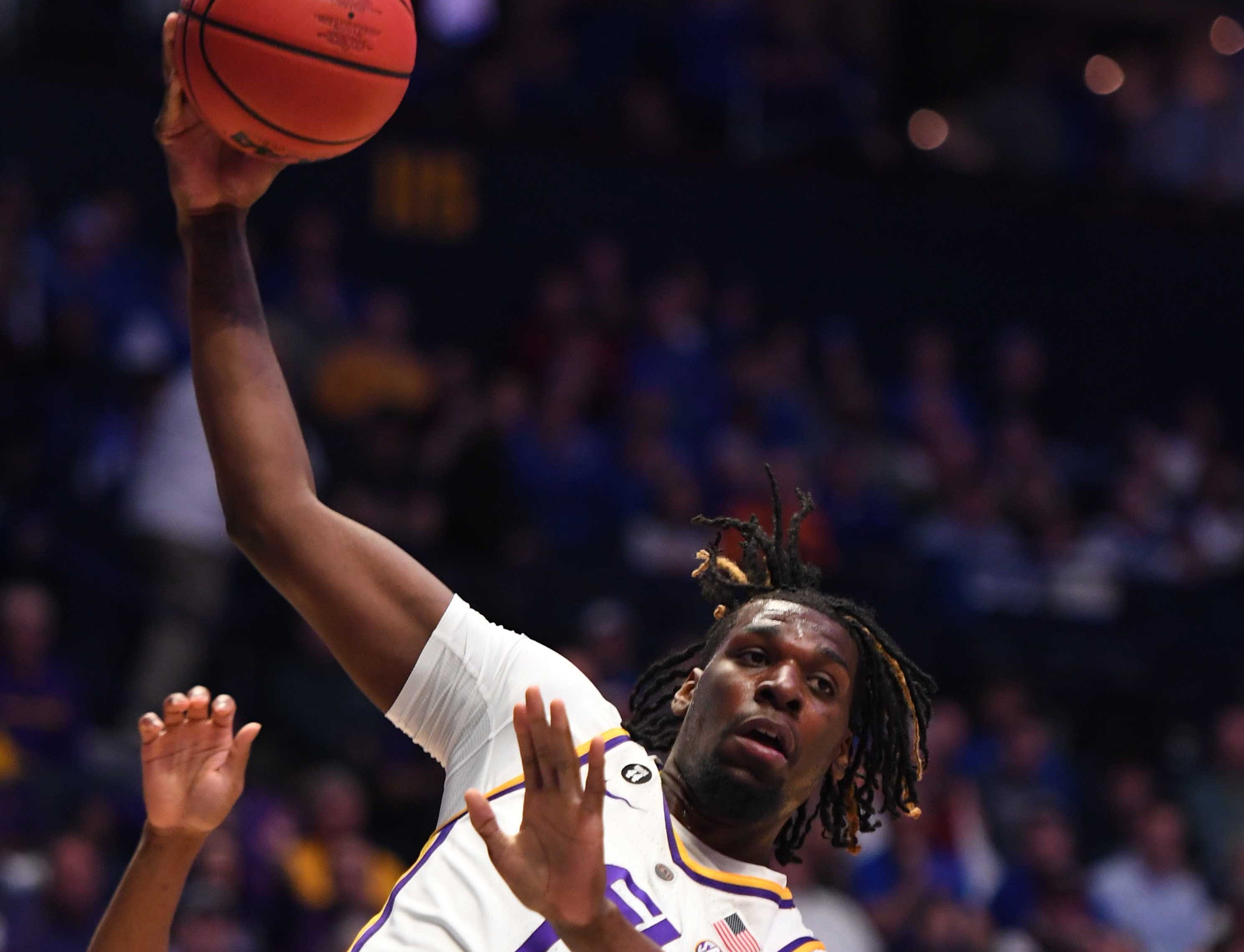 Mar 15, 2019; Nashville, TN, USA; LSU Tigers forward Naz Reid (0) grabs a rebound over Florida Gators center Kevarrius Hayes (13) during the first half of the SEC conference tournament at Bridgestone Arena. Mandatory Credit: Christopher Hanewinckel-USA TODAY Sports