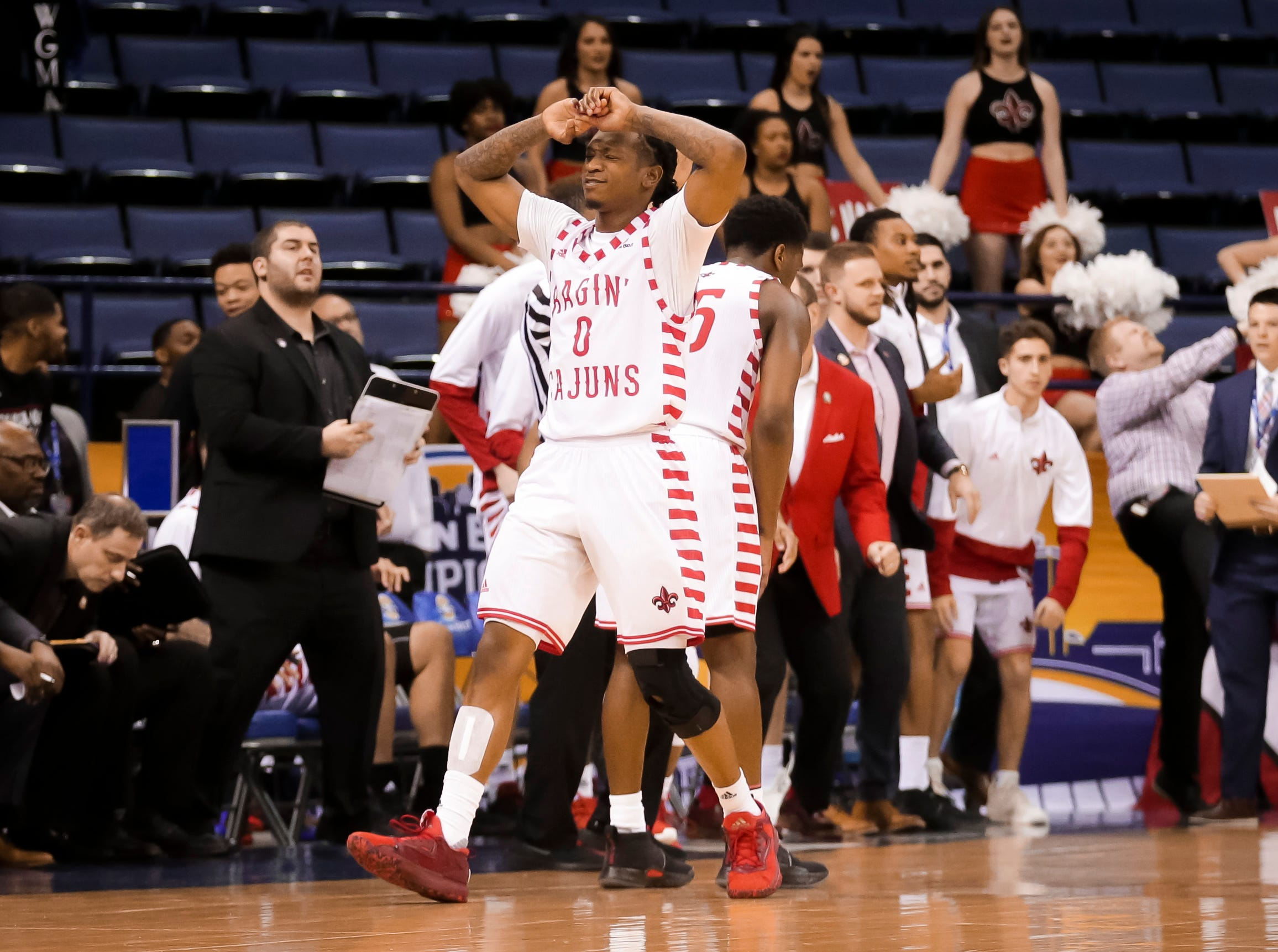 UL's Cedric Russell reacts to a 70-69 loss to South Alabama on Thursday at the Sun Belt Men's Basketball Championship in New Orleans.