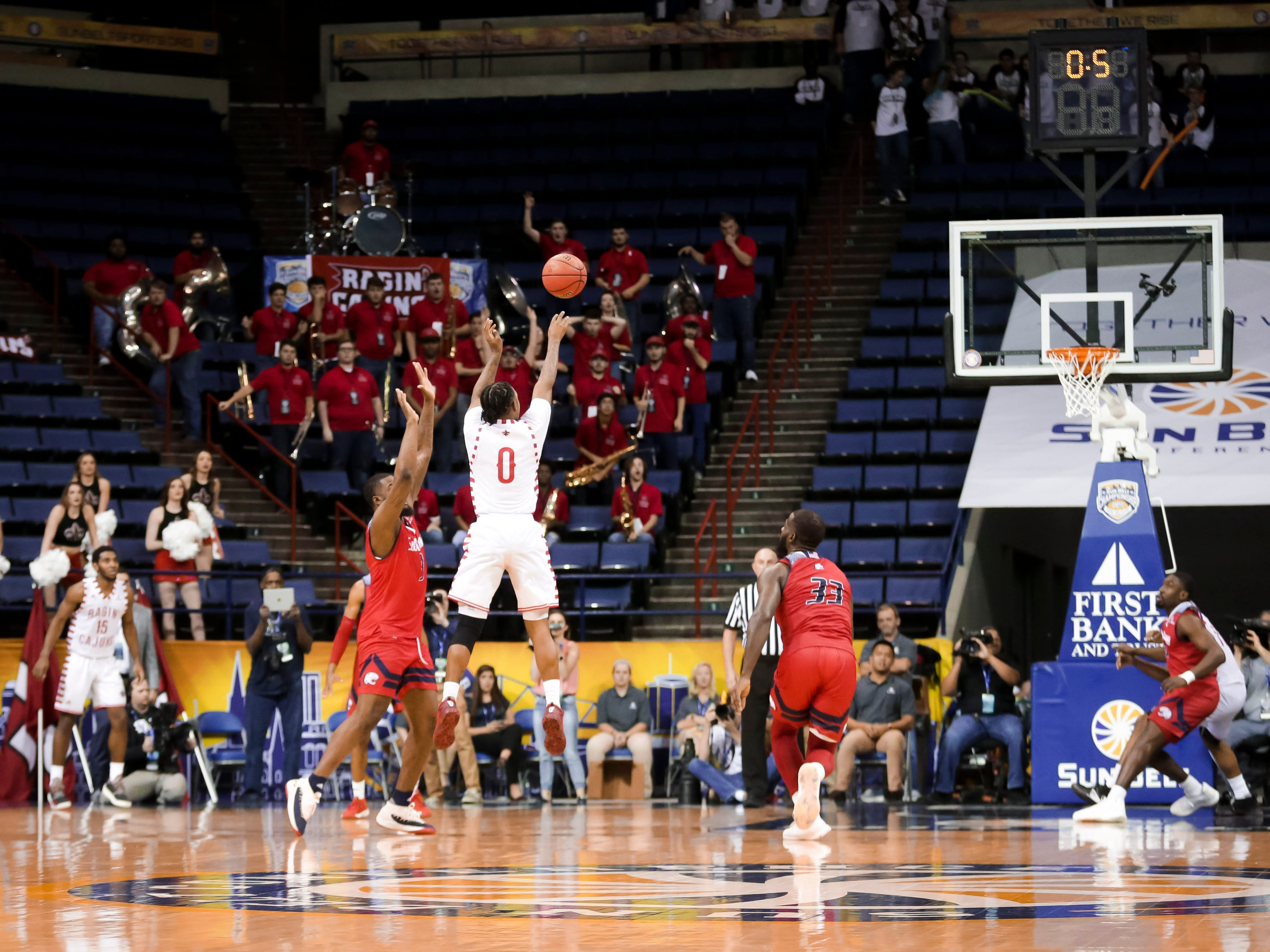 UL sophomore guard Cedric Russell puts up a shot at the buzzer, as the Ragin' Cajuns fell to South Alabama, 70-69, on Thursday at the Sun Belt Men's Basketball Championship in New Orleans.