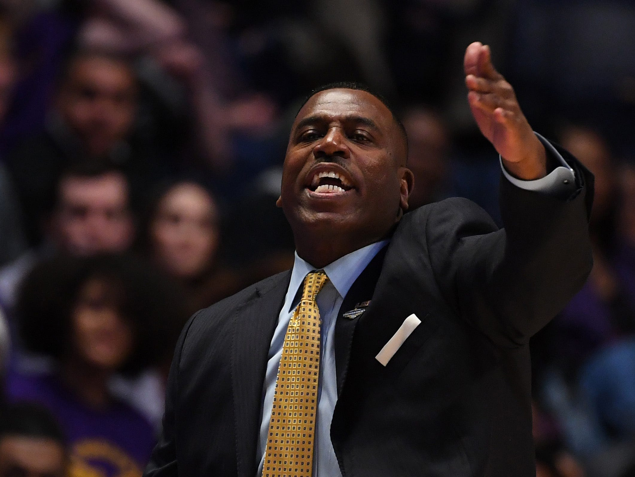 Mar 15, 2019; Nashville, TN, USA; LSU Tigers interim head coach Tony Benford reacts on the sidelines against the Florida Gators during the first half of the SEC conference tournament at Bridgestone Arena. Mandatory Credit: Christopher Hanewinckel-USA TODAY Sports