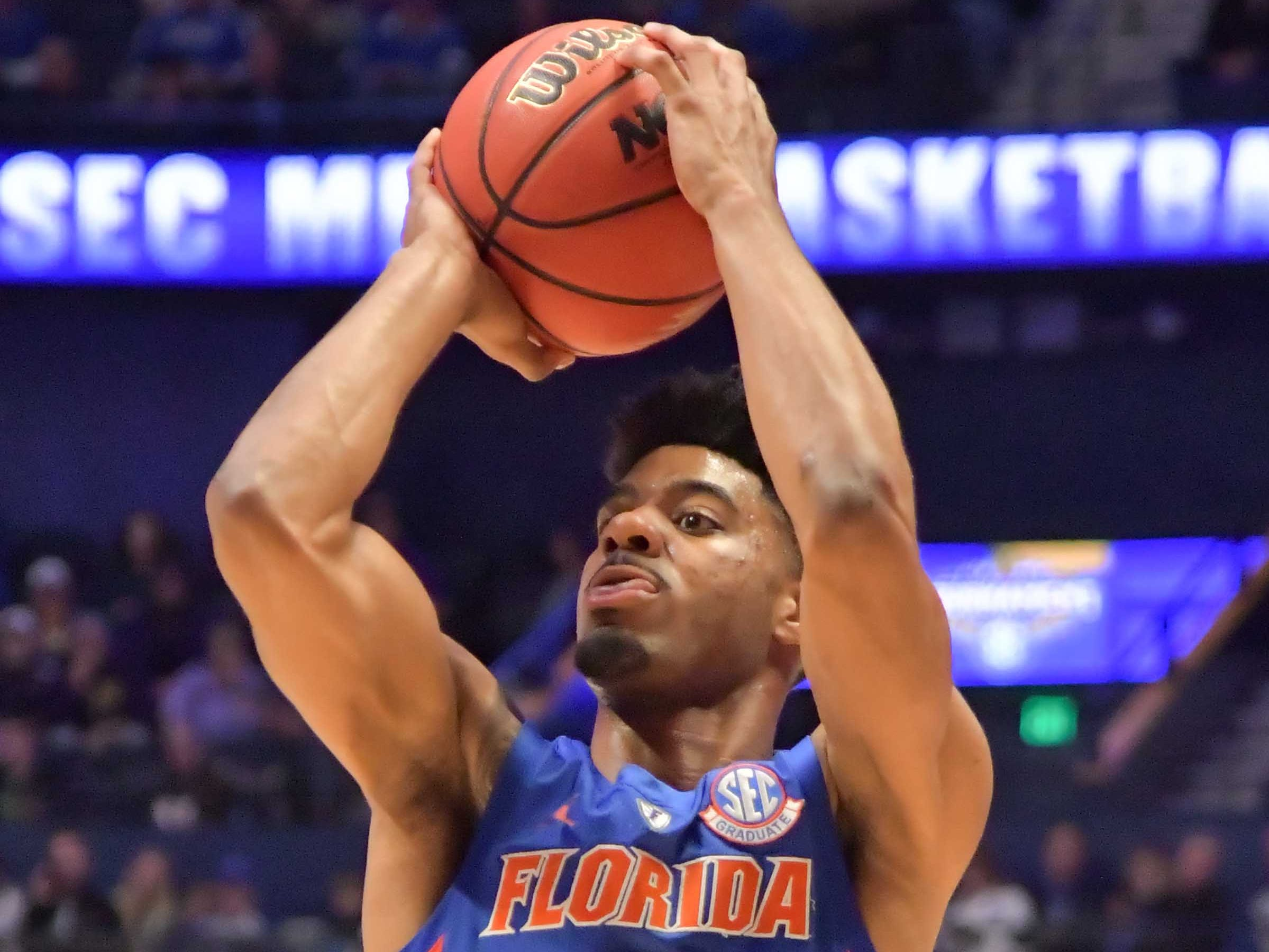 Mar 15, 2019; Nashville, TN, USA; Florida Gators guard Jalen Hudson (3) shoots against the LSU Tigers during the first half of game seven in the SEC conference tournament at Bridgestone Arena. Mandatory Credit: Jim Brown-USA TODAY Sports