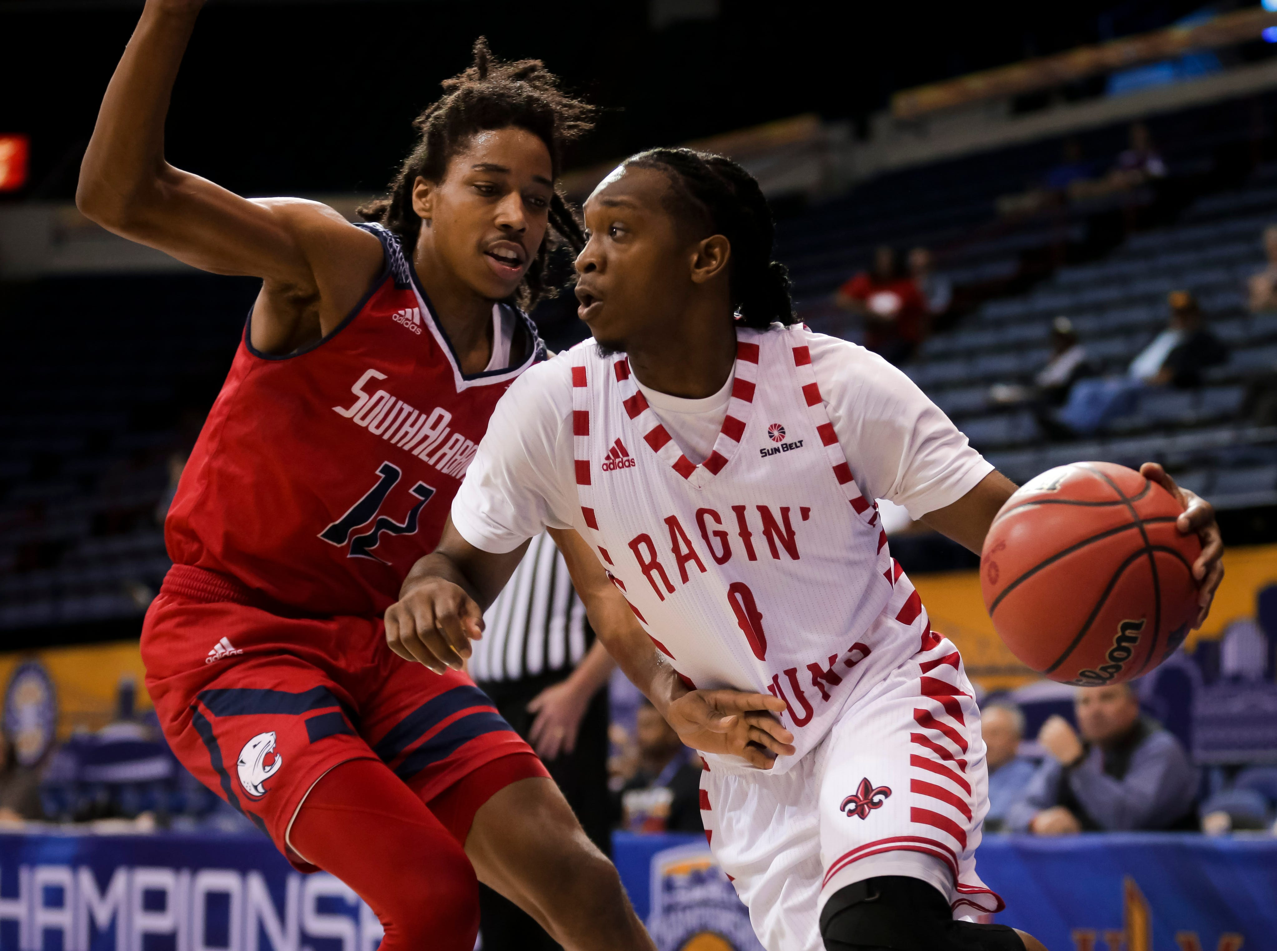UL sophomore guard Cedric Russell drives against South Alabama on Thursday at the Sun Belt Men's Basketball Championship in New Orleans.