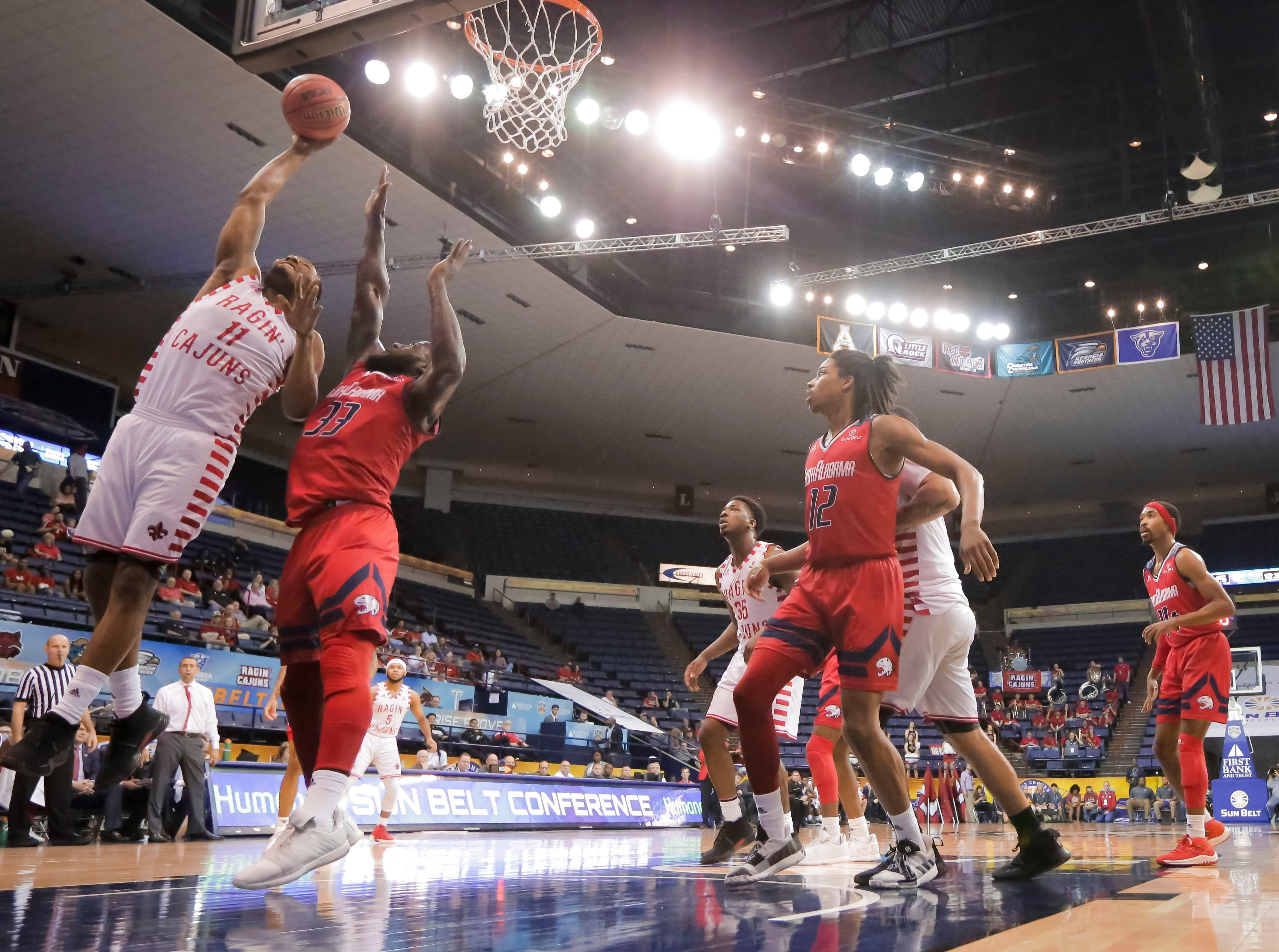UL's Jerekius Davis goes up for 2, as the Ragin' Cajuns fell to South Alabama, 70-69, on Thursday at the Sun Belt Men's Basketball Championship in New Orleans.