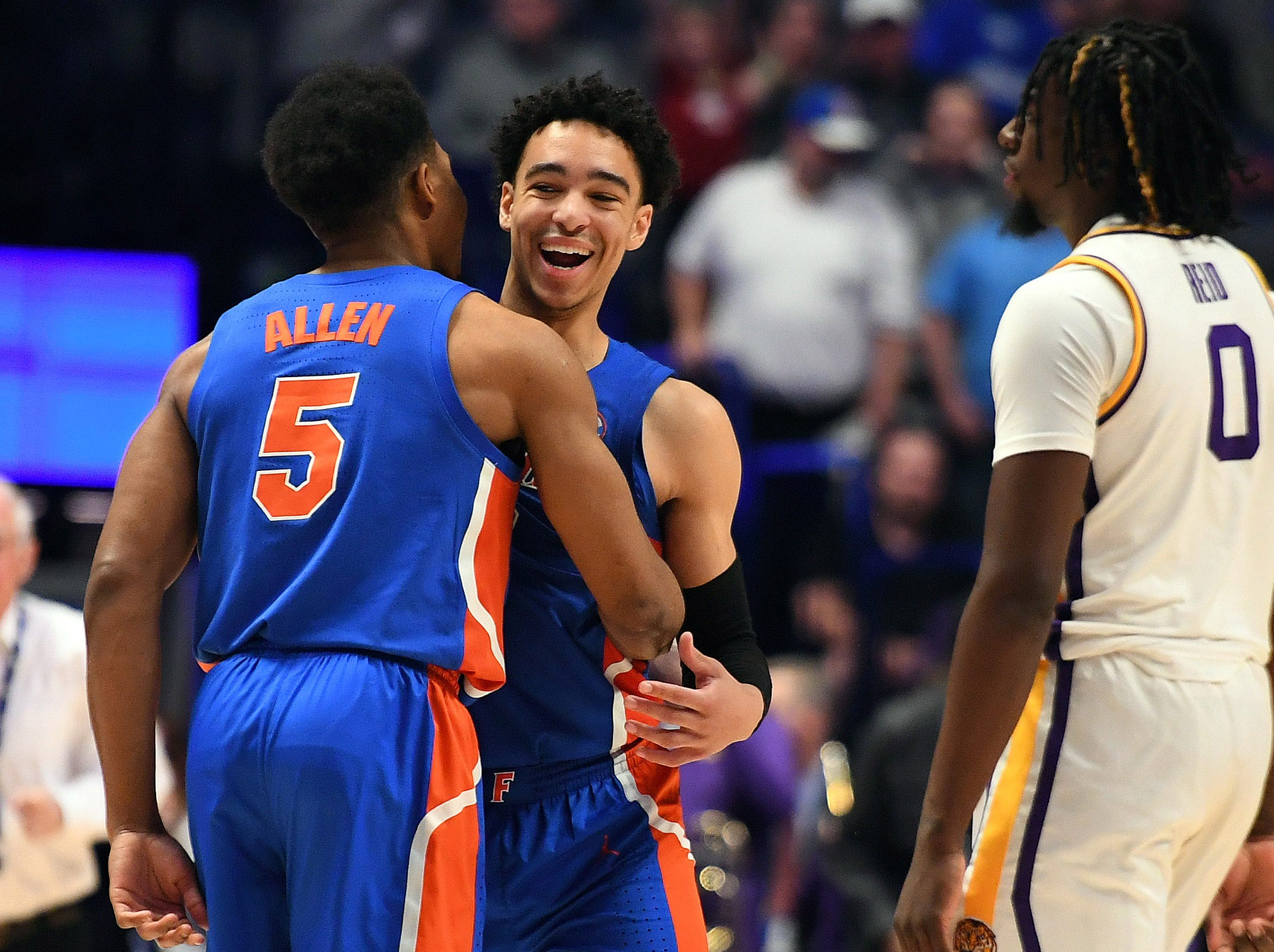 Mar 15, 2019; Nashville, TN, USA; Florida Gators guard KeVaughn Allen (5) and Gators guard Andrew Nembhard (2) celebrate after defeating the LSU Tigers in the SEC conference tournament at Bridgestone Arena. Mandatory Credit: Christopher Hanewinckel-USA TODAY Sports