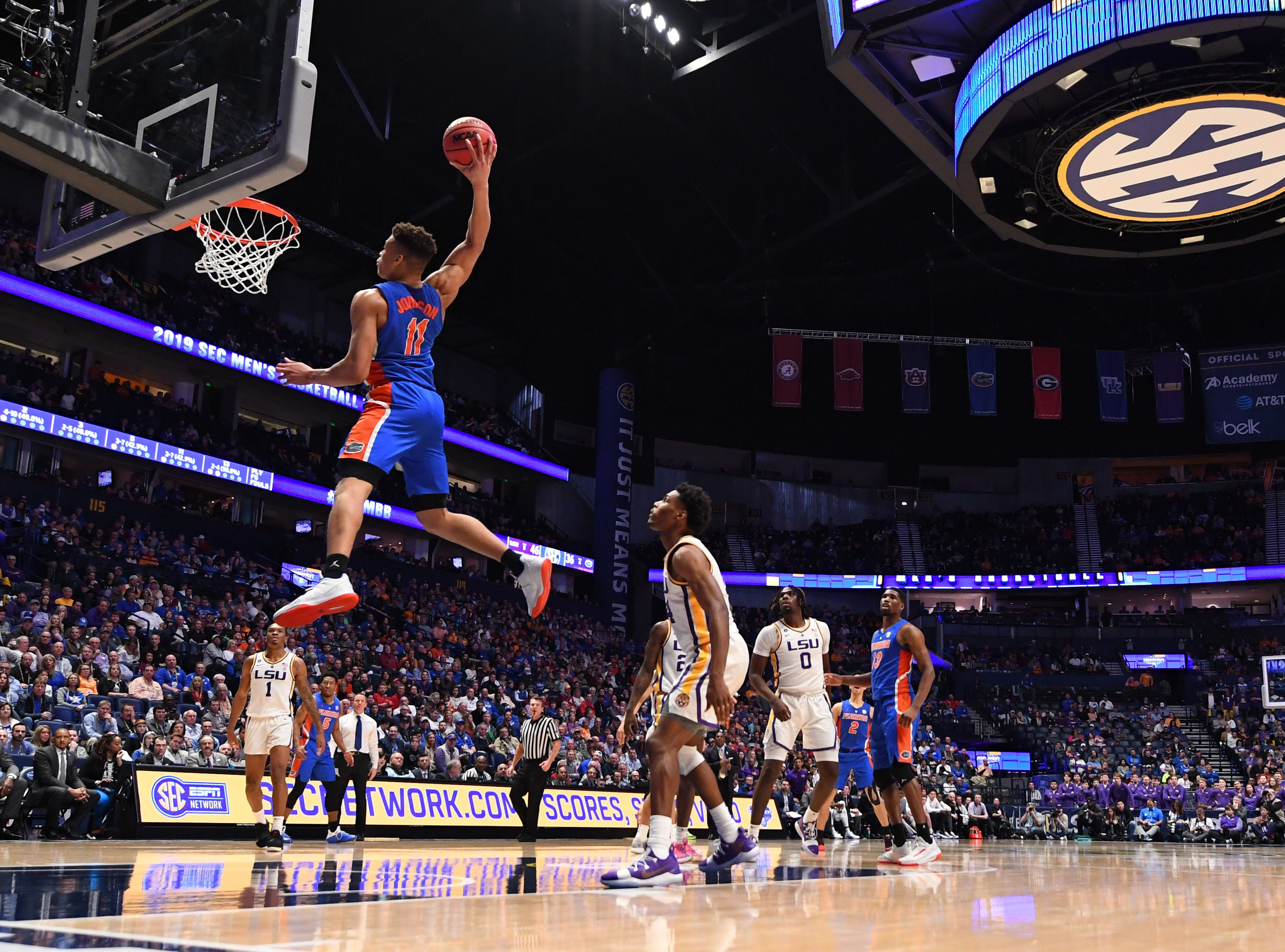Mar 15, 2019; Nashville, TN, USA; Florida Gators forward Keyontae Johnson (11) dunks the ball against the LSU Tigers during the second half of the SEC conference tournament at Bridgestone Arena. Mandatory Credit: Christopher Hanewinckel-USA TODAY Sports