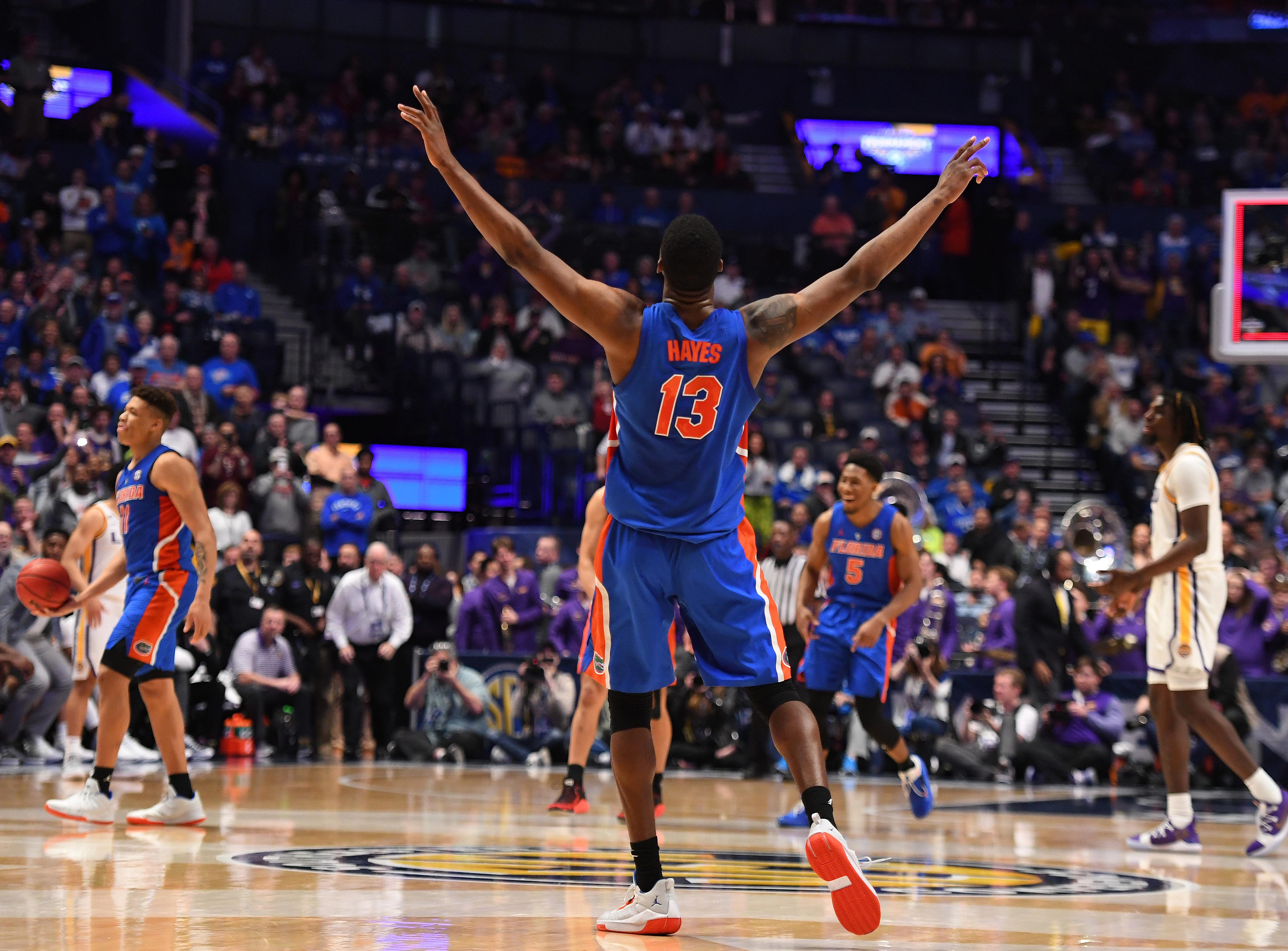 Mar 15, 2019; Nashville, TN, USA; Florida Gators center Kevarrius Hayes (13) celebrates after defeating the LSU Tigers in the SEC conference tournament at Bridgestone Arena. Mandatory Credit: Christopher Hanewinckel-USA TODAY Sports