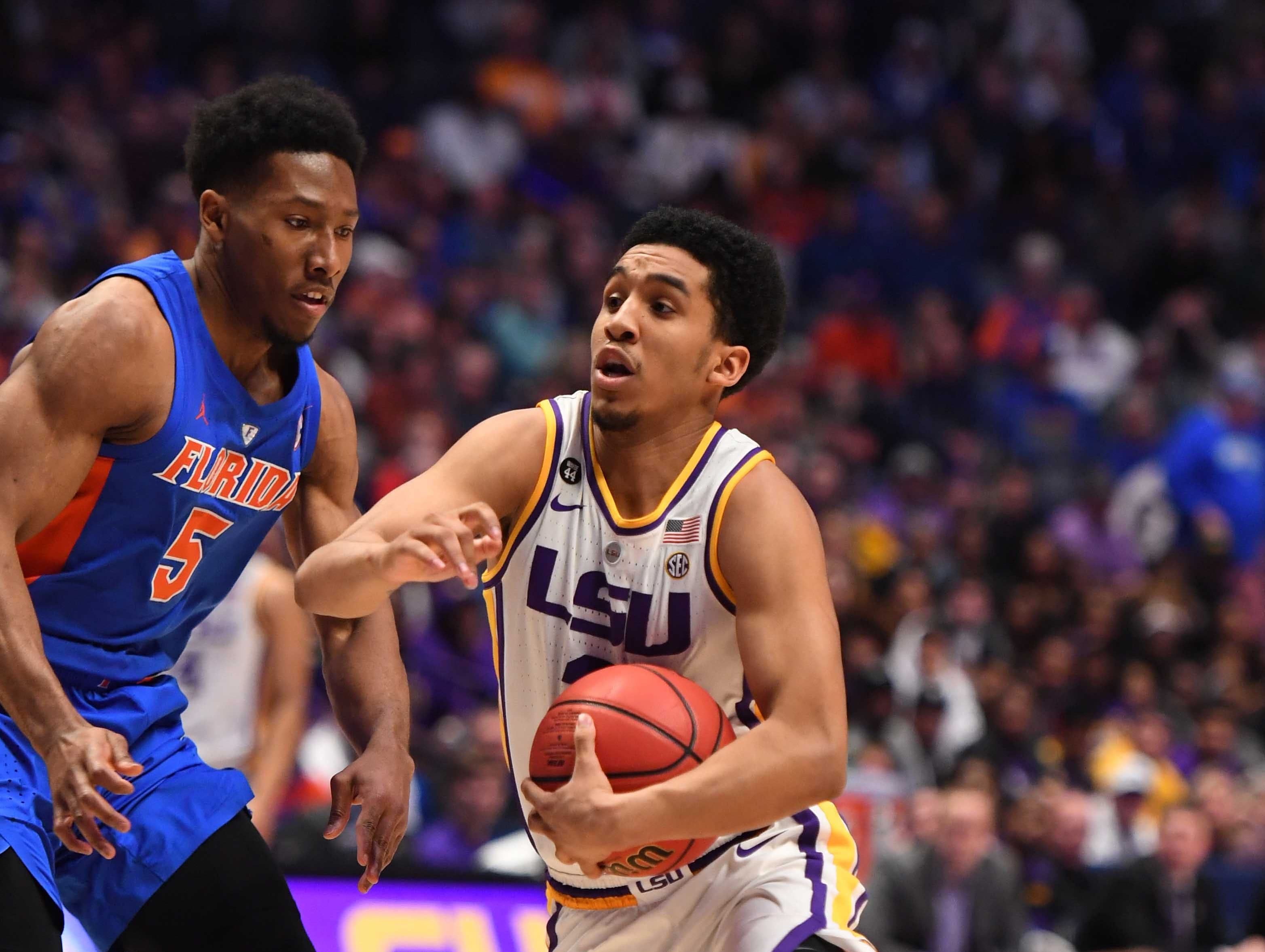 Mar 15, 2019; Nashville, TN, USA; LSU Tigers guard Tremont Waters (3) drives to the basket against Florida Gators guard KeVaughn Allen (5) during the first half of the SEC conference tournament at Bridgestone Arena. Mandatory Credit: Christopher Hanewinckel-USA TODAY Sports