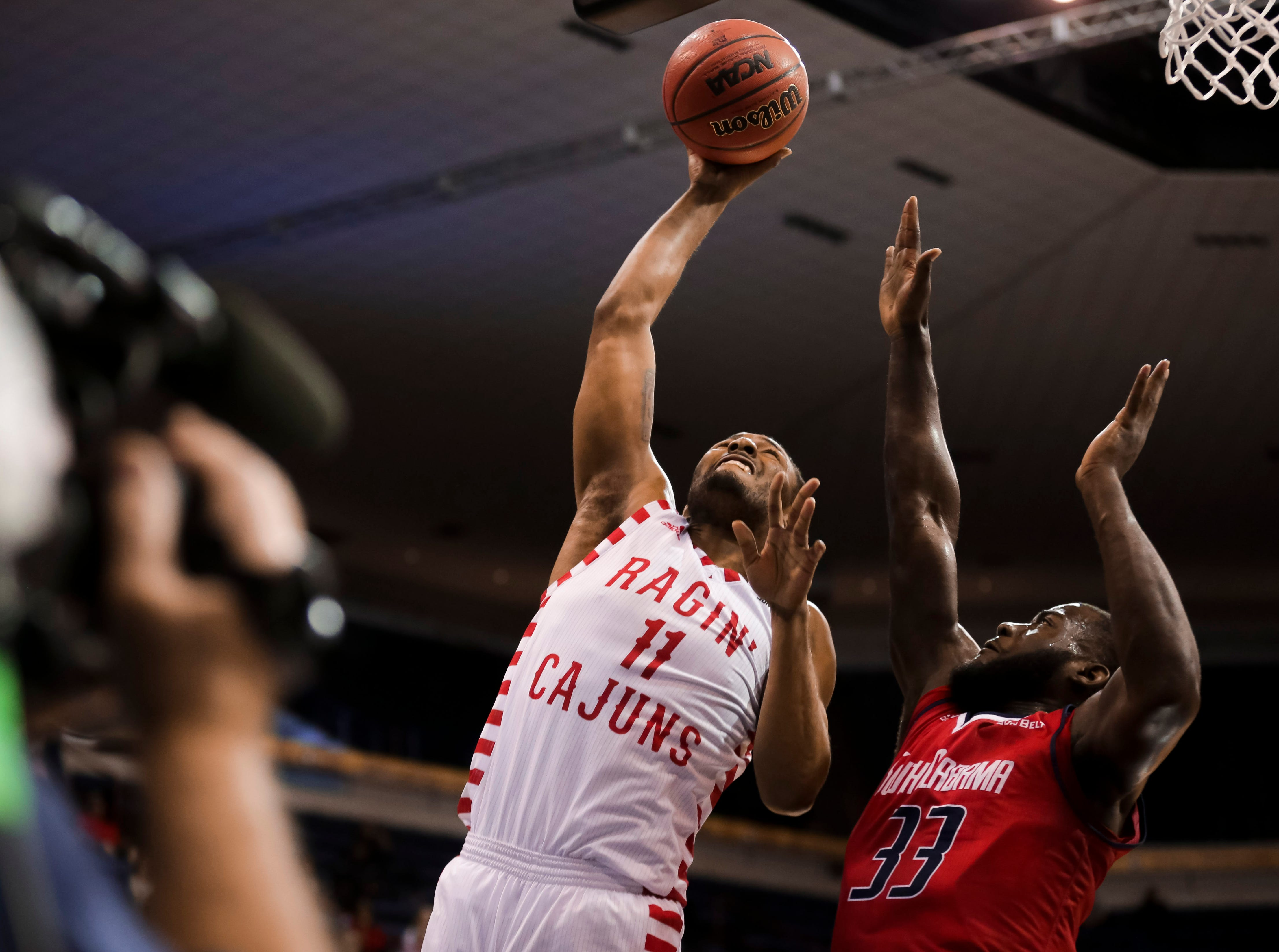 UL junior Jerekius Davis goes up for a basket against South Alabama on Thursday at the Sun Belt Men's Basketball Championship in New Orleans.