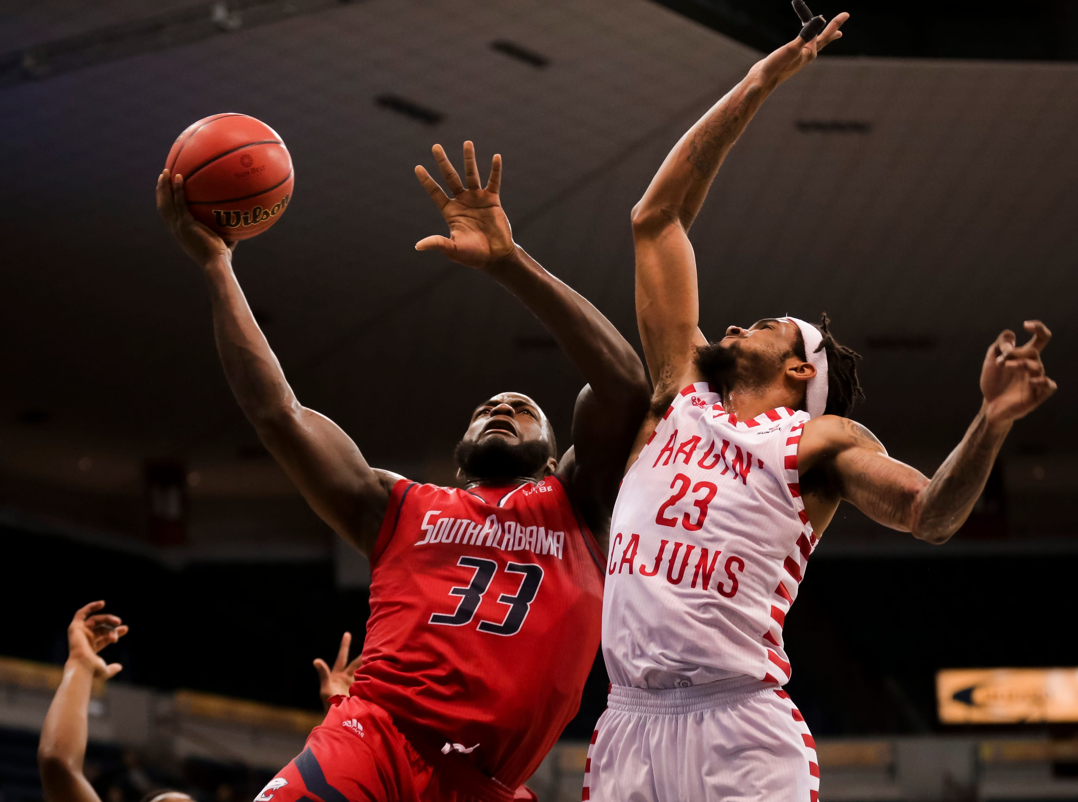 UL's Jakeenan Gant defends, as the Ragin' Cajuns fell to South Alabama, 70-69, on Thursday at the Sun Belt Men's Basketball Championship in New Orleans.